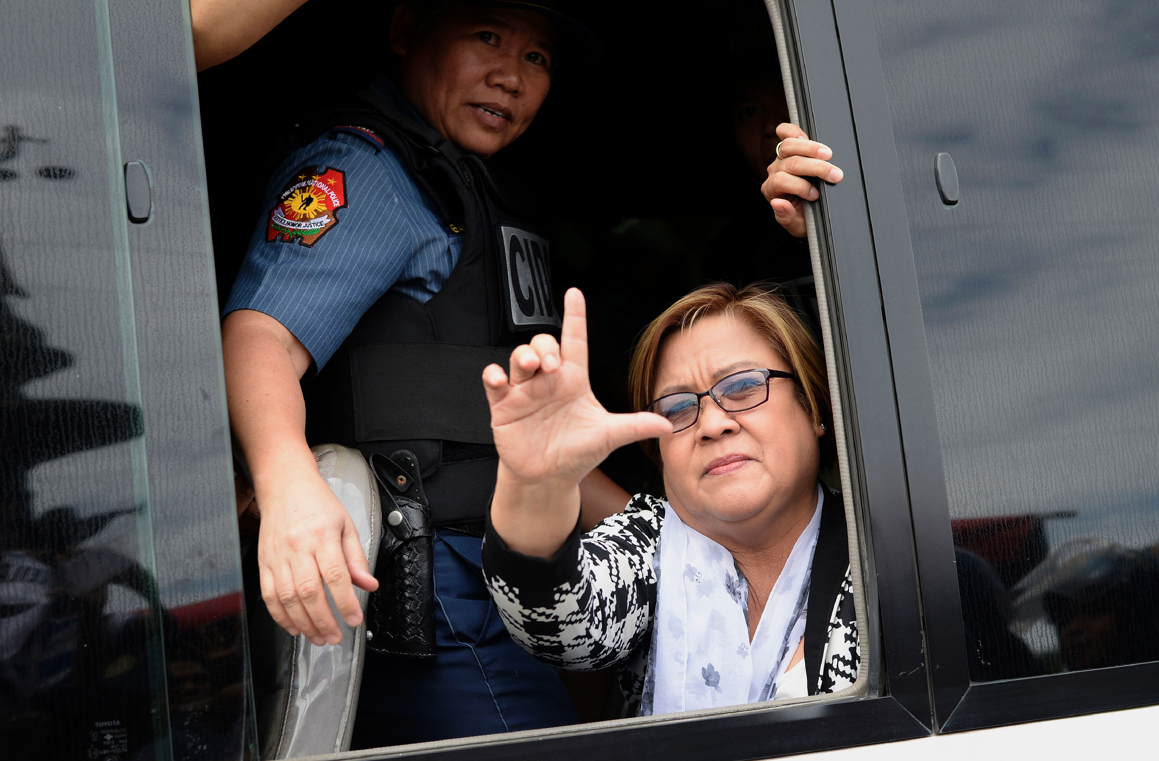 Philippine Senator Leila de Lima, a former human-rights commissioner who is one of Duterte's most vocal opponents, waves to her supporters after appearing at a court in Muntinlupa City, suburban Manila, on Feb. 24, 2017