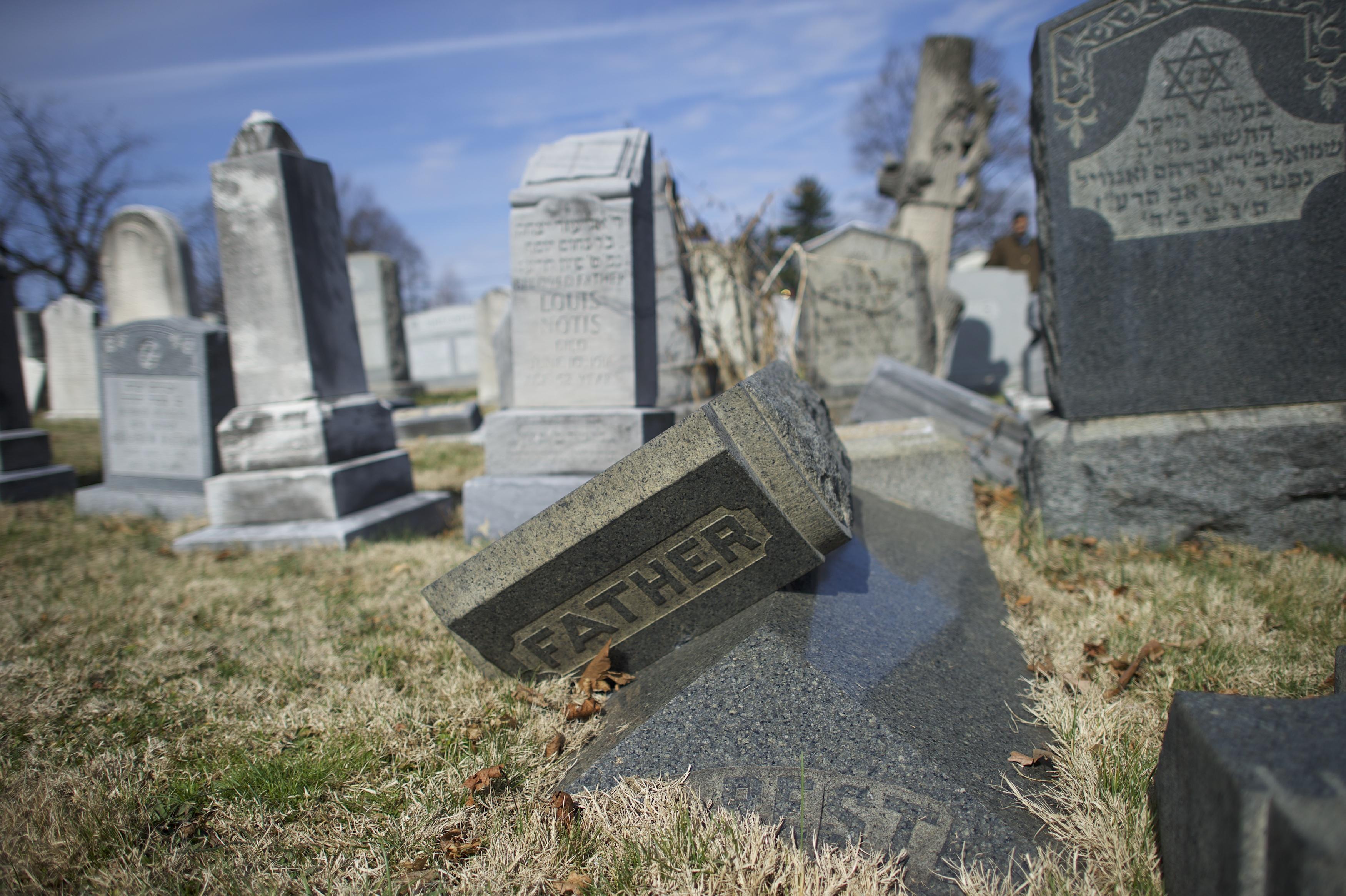 Jewish tombstones lay vandalized at Mount Carmel Cemetery February 27, 2017 in Philadelphia, Pennsylvania.  (Mark Makela--Getty Images)