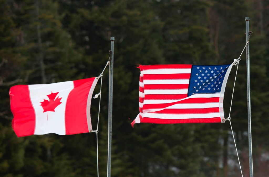 Canadian and American flags are seen at the US/Canada border March 1, 2017, in Pittsburg, New Hampshire.