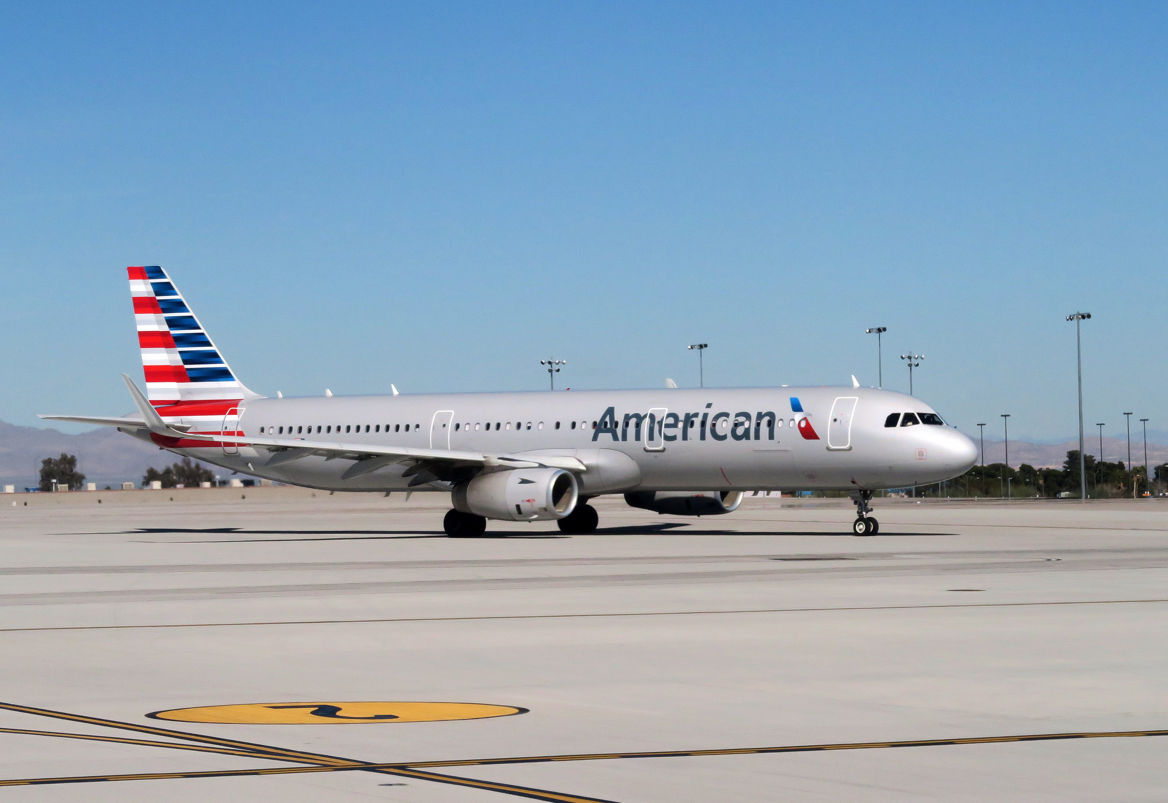 An American Airlines plane sits on the tarmac of McCarran International Airport in Las Vegas, Nevada on February 15, 2017.