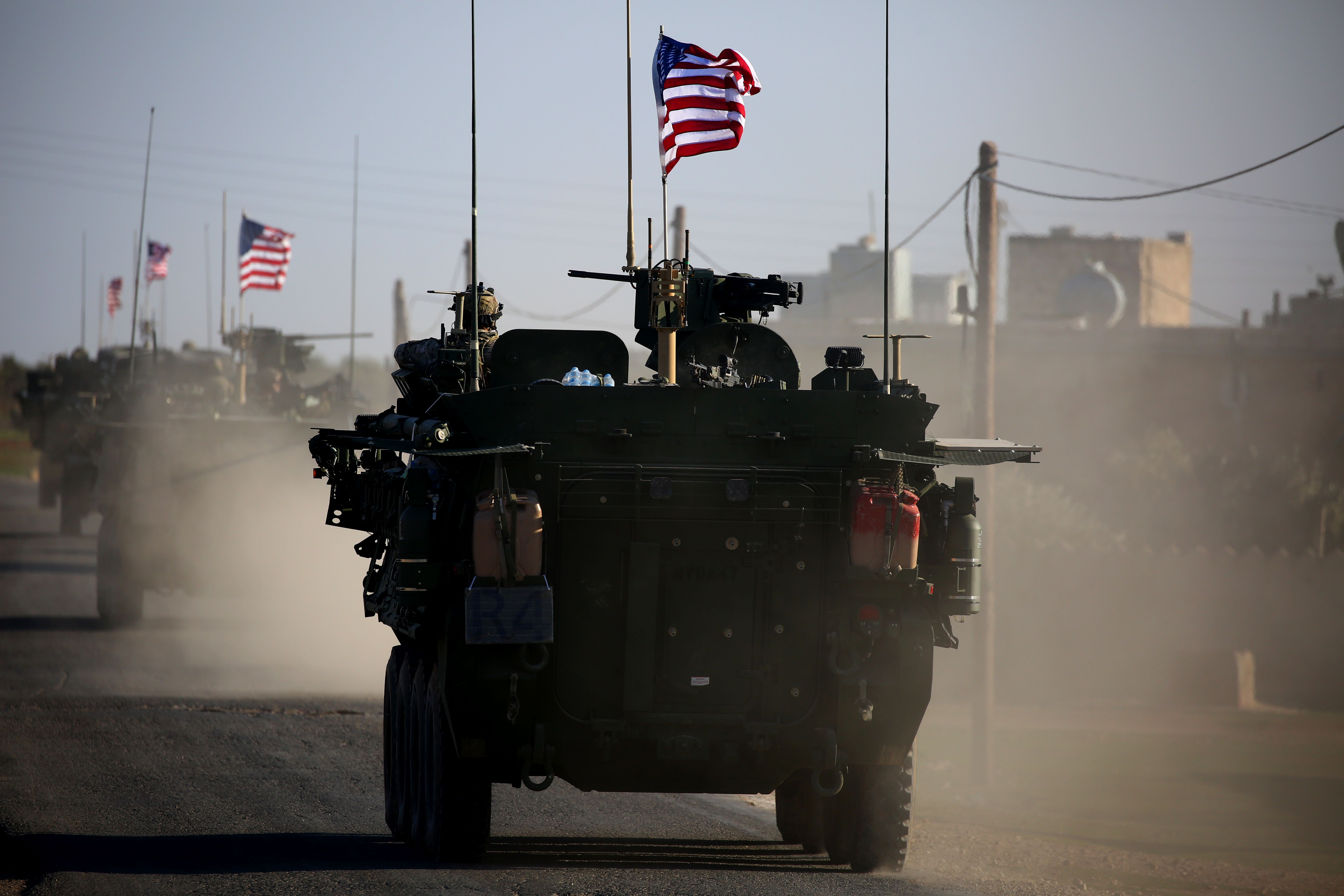 A convoy of U.S. forces armored vehicles drives near the village of Yalanli, on the western outskirts of the northern Syrian city of Manbij on March 5, 2017