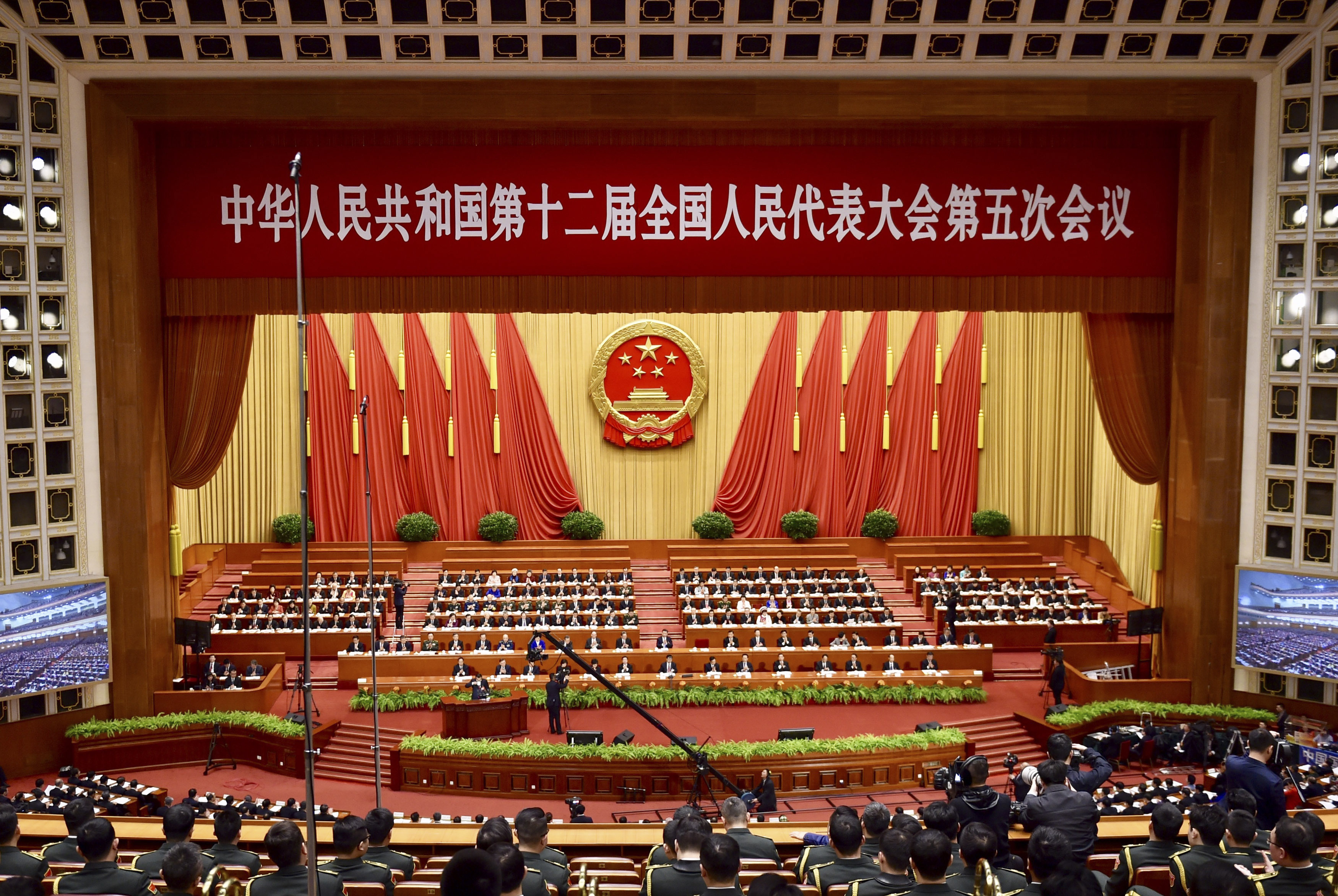 Delegates attend the Fifth Session of the 12th National People's Congress on March 5, 2017, in Beijing