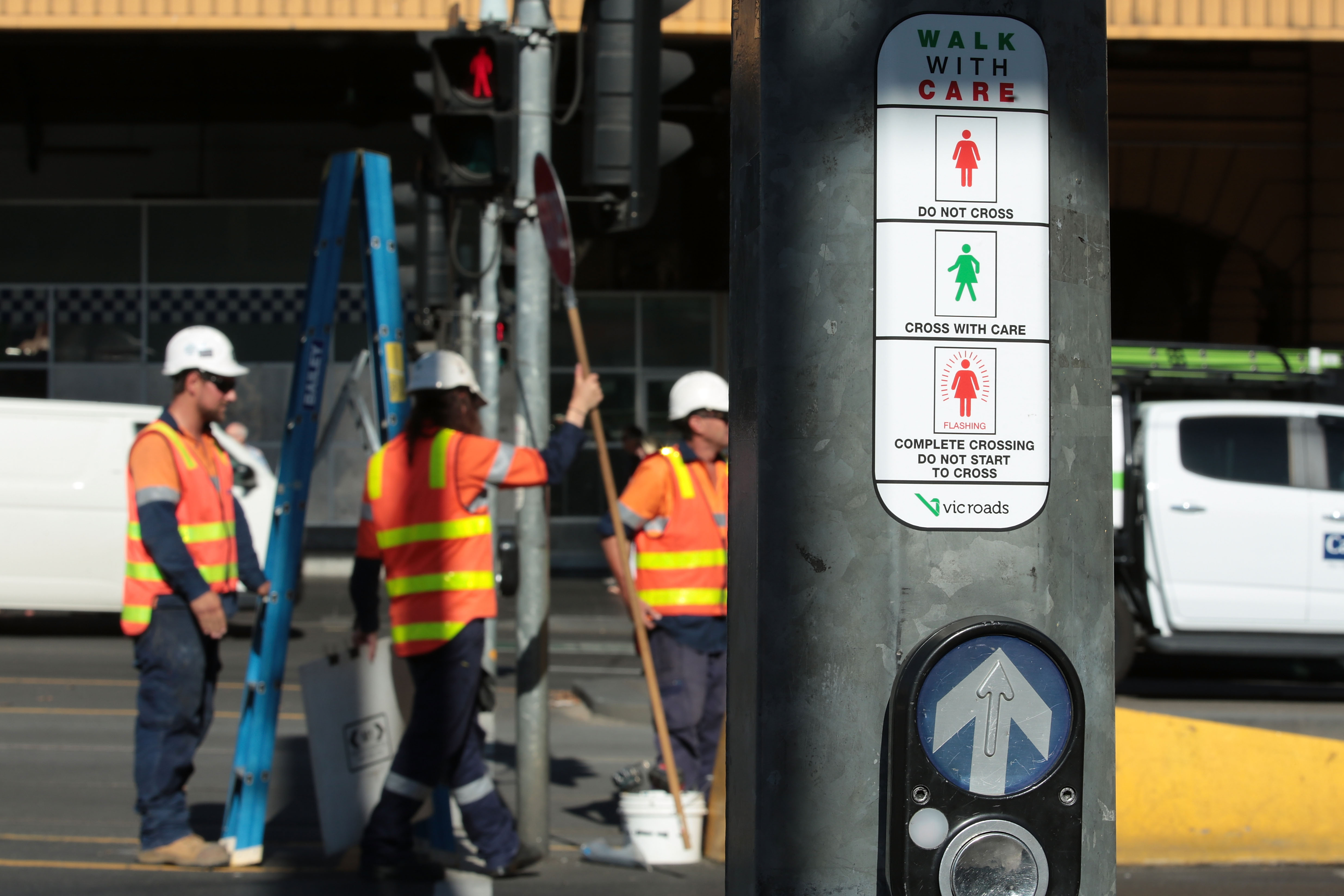 Female traffic light signals are installed an intersection in Melbourne, Australia on March 7, 2017.
