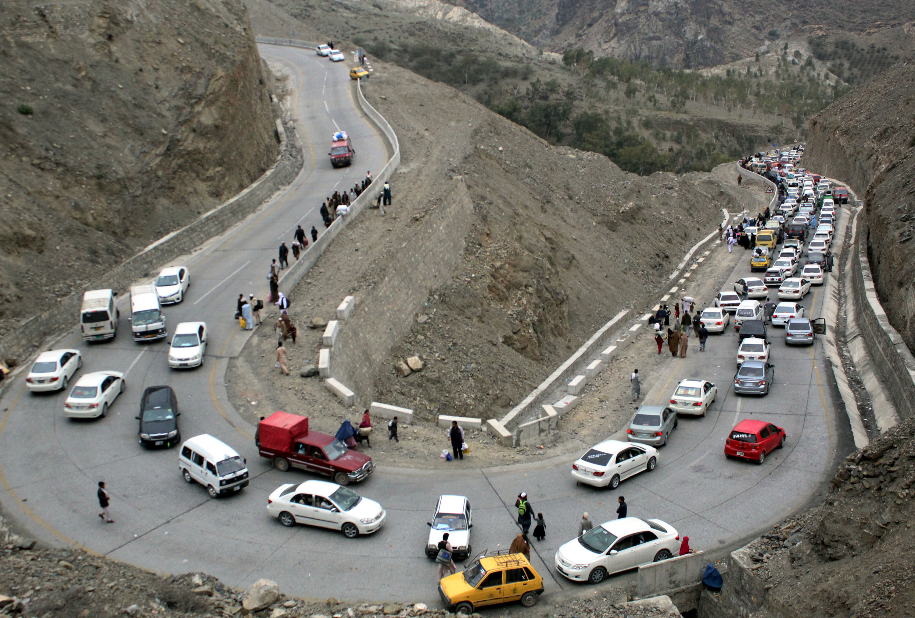 Vehicles en route to Afghanistan line up near the Pakistani-Afghan border in northwest Pakistan's Torkham on March 7, 2017