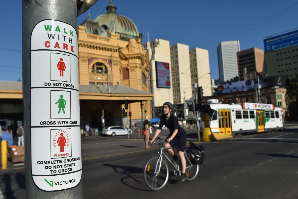 Instructions for new pedestrian traffic signals designed to equal the gender balance on International Women's Day in Melbourne on March 8, 2017.