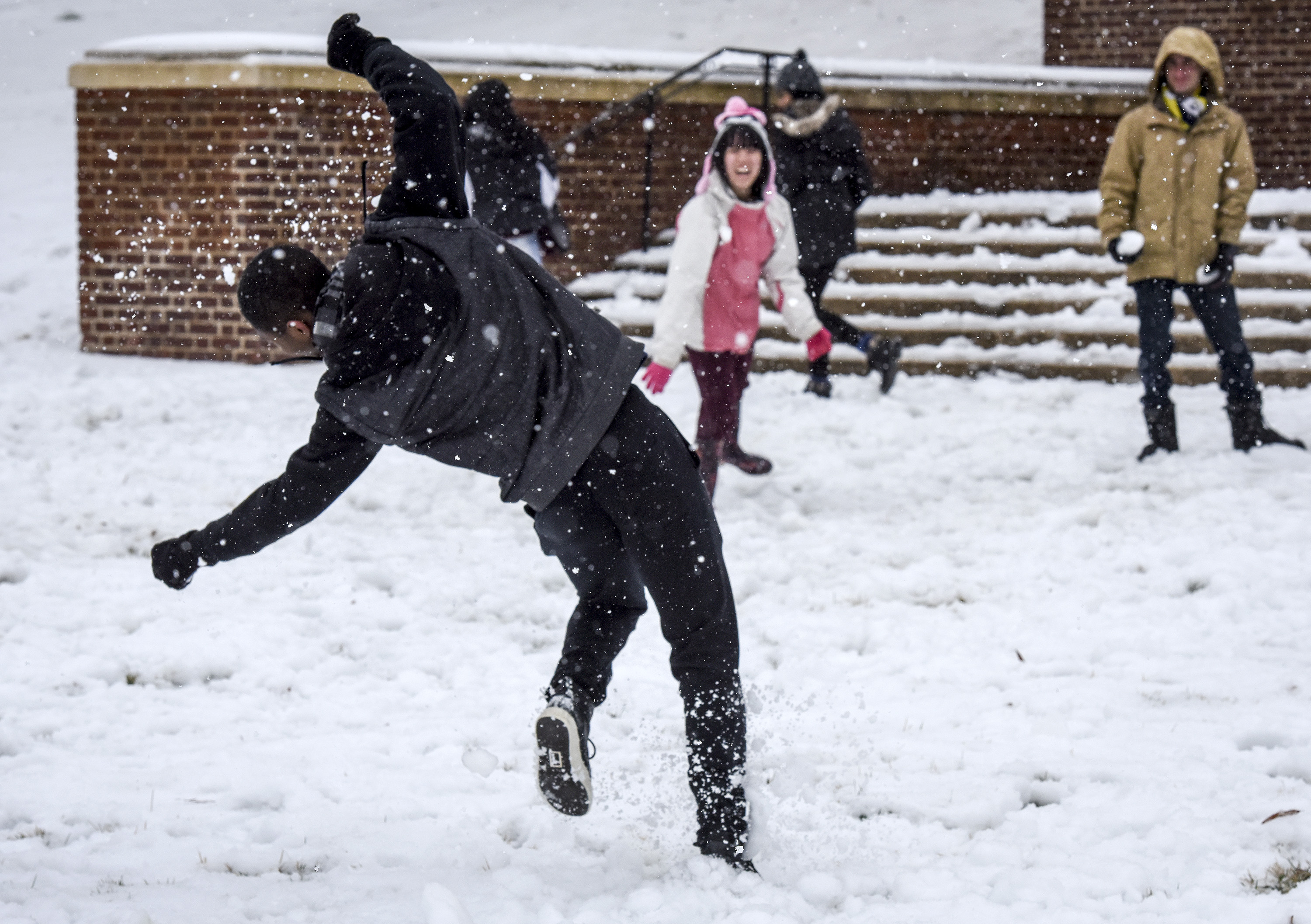 COLLEGE PARK, MD - MARCH 14:                       Freshman Chika Okusogu tries to dodge an icy snowball on campus at the University of Maryland after the first significant winter storm of the season on March, 14, 2017 in College Park, MD.                        (Photo by Bill O'Leary/The Washington Post via Getty Images)