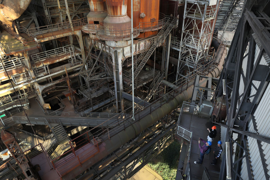 VOELKLINGEN, GERMANY - MARCH 15:  Visitors walk among the innards of the former Voelklinger Huette ironworks on March 15, 2017 in Voelklingen, Germany. Voelklinger Huette once employed tens of thousands of workers. It ceased production in 1986 and today is a tourist attraction and a UNESCO World Heritage site. Voelklingen is in the industrial heartland of Saarland, the small German state that borders France and has a long history of coal and steel production. Saarland faces state elections on March 26 and so far the Christian Democrats (CDU) and Social Democrats (SPD) are leading in polls. The right-wing populist Alternative for Germany (AfD) has slipped in polls in the last two months, though it is still likely to get seats in the state parliament.  (Photo by Sean Gallup/Getty Images)