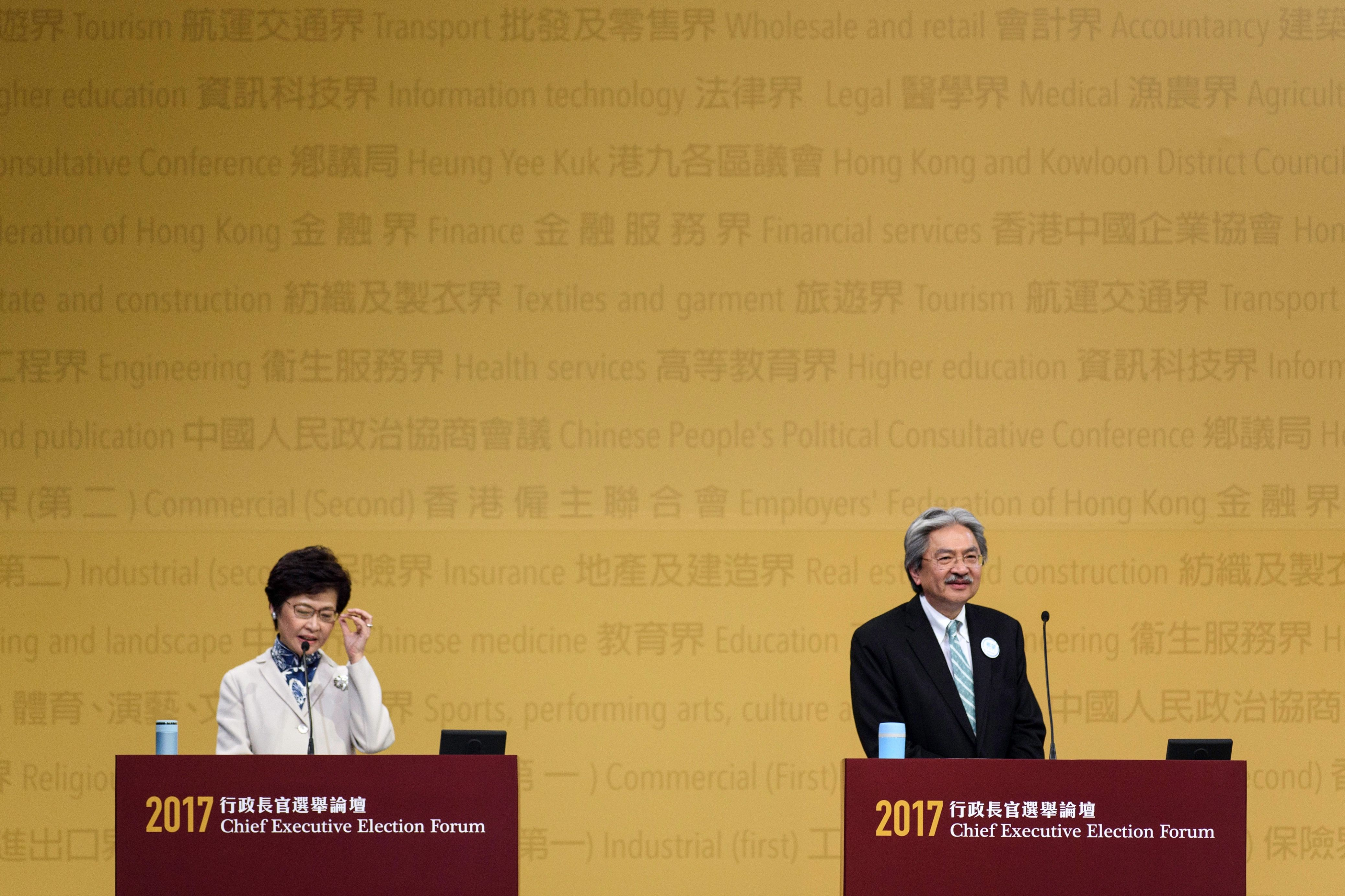Hong Kong's Chief Executive candidates Carrie Lam and John Tsang on stage during the Chief Executive Election Forum in Hong Kong on March 19, 2017