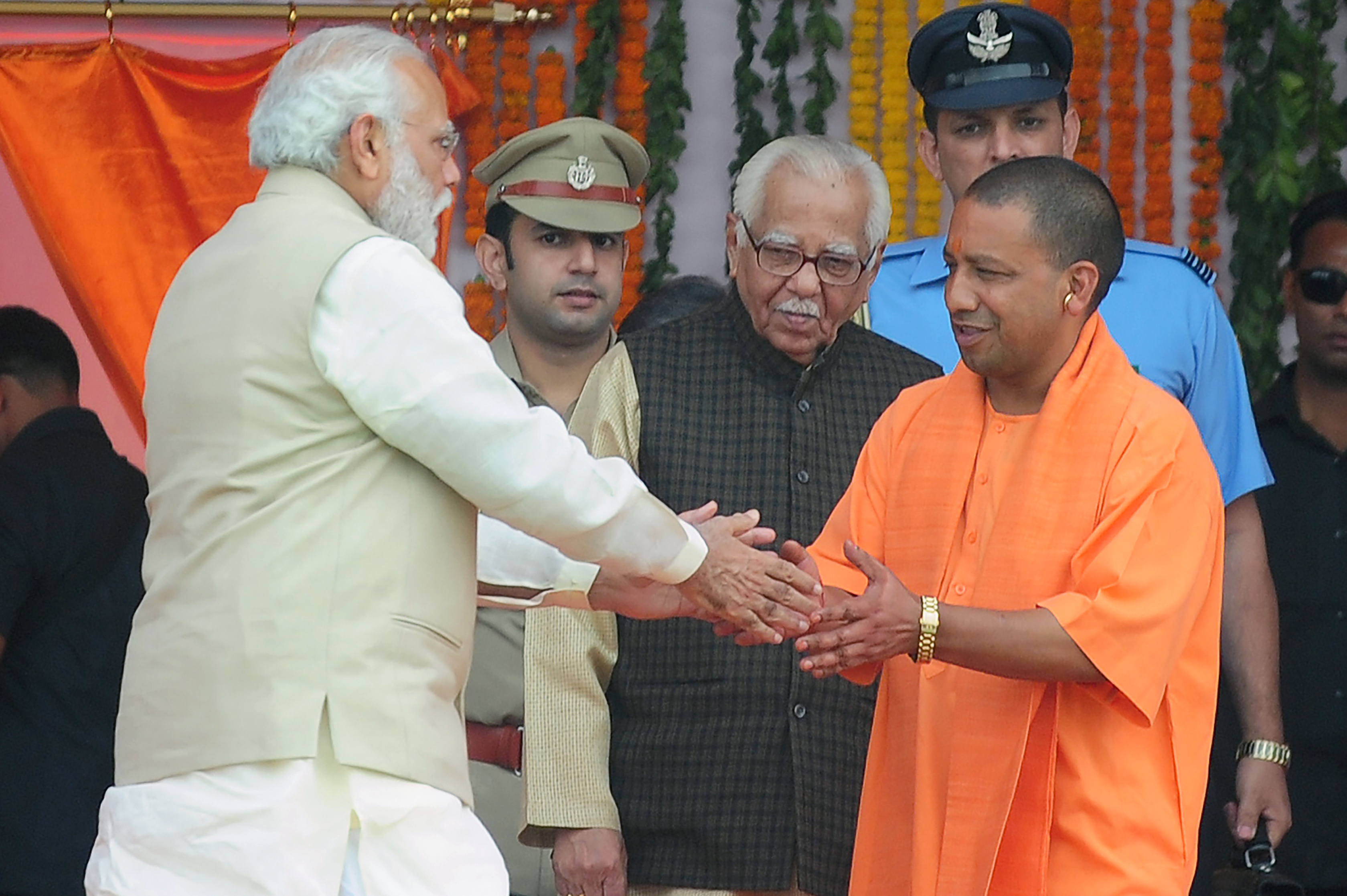Indian Prime Minister Narendra Modi, left, greets Yogi Adityanath, chief minister of Uttar Pradesh state, at his swearing-in ceremony in Lucknow, India, on March 19, 2017