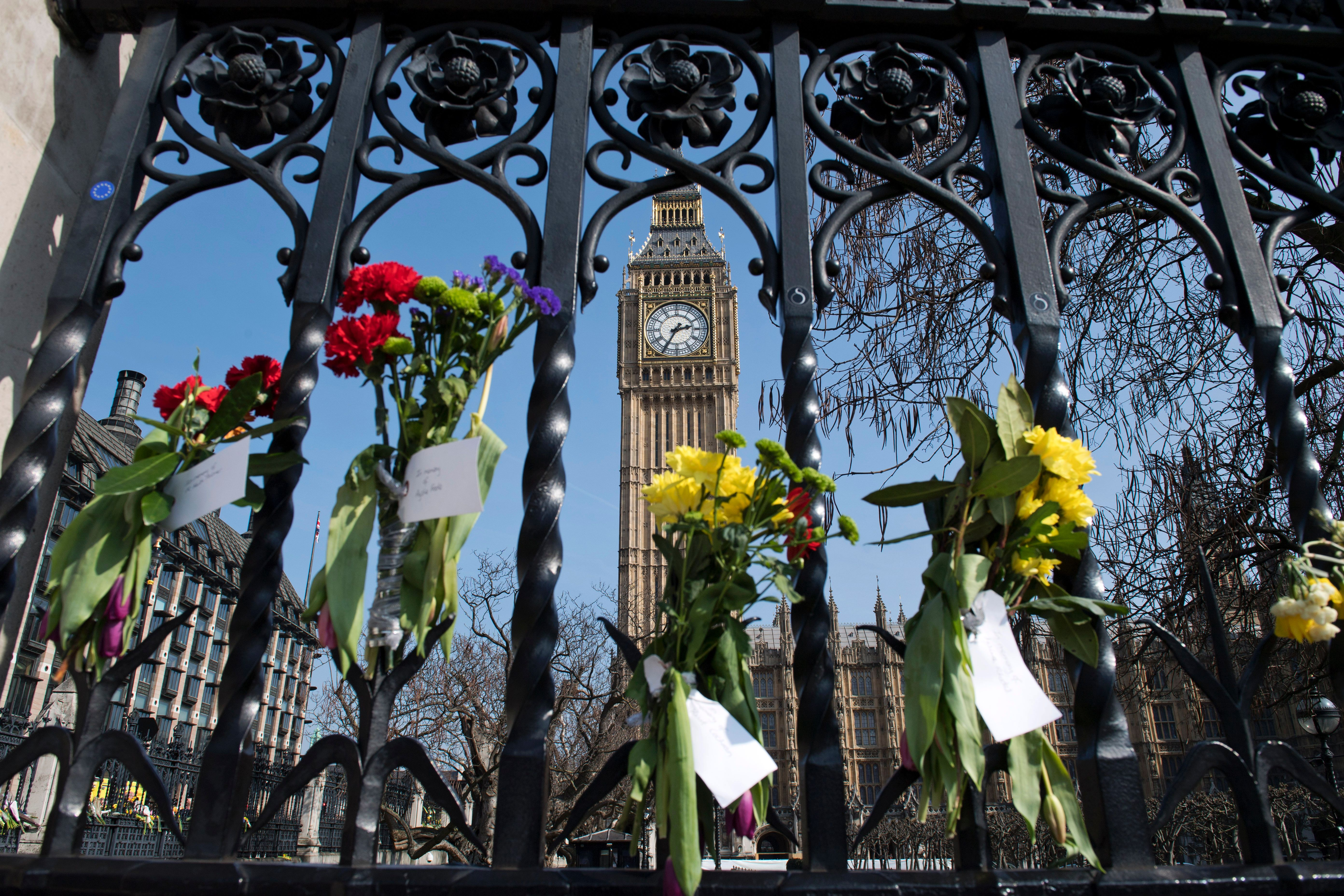 Floral tributes to the victims of the March 22 terror attack are seen on outside the Houses of Parliament in Westminster, central London, on March 27, 2017