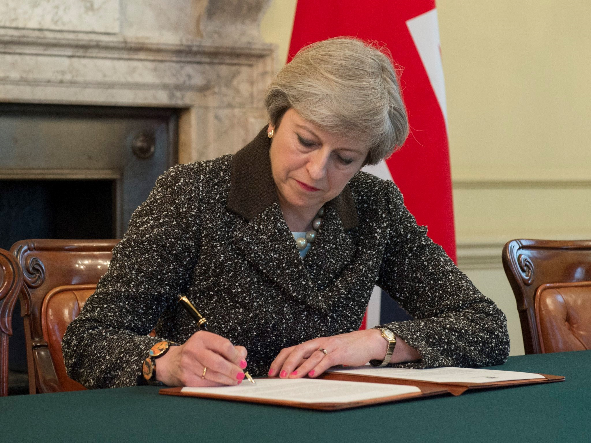 British Prime Minister Theresa May signs the letter to Donald Tusk invoking Article 50 on March 28, 2017 in London, England.