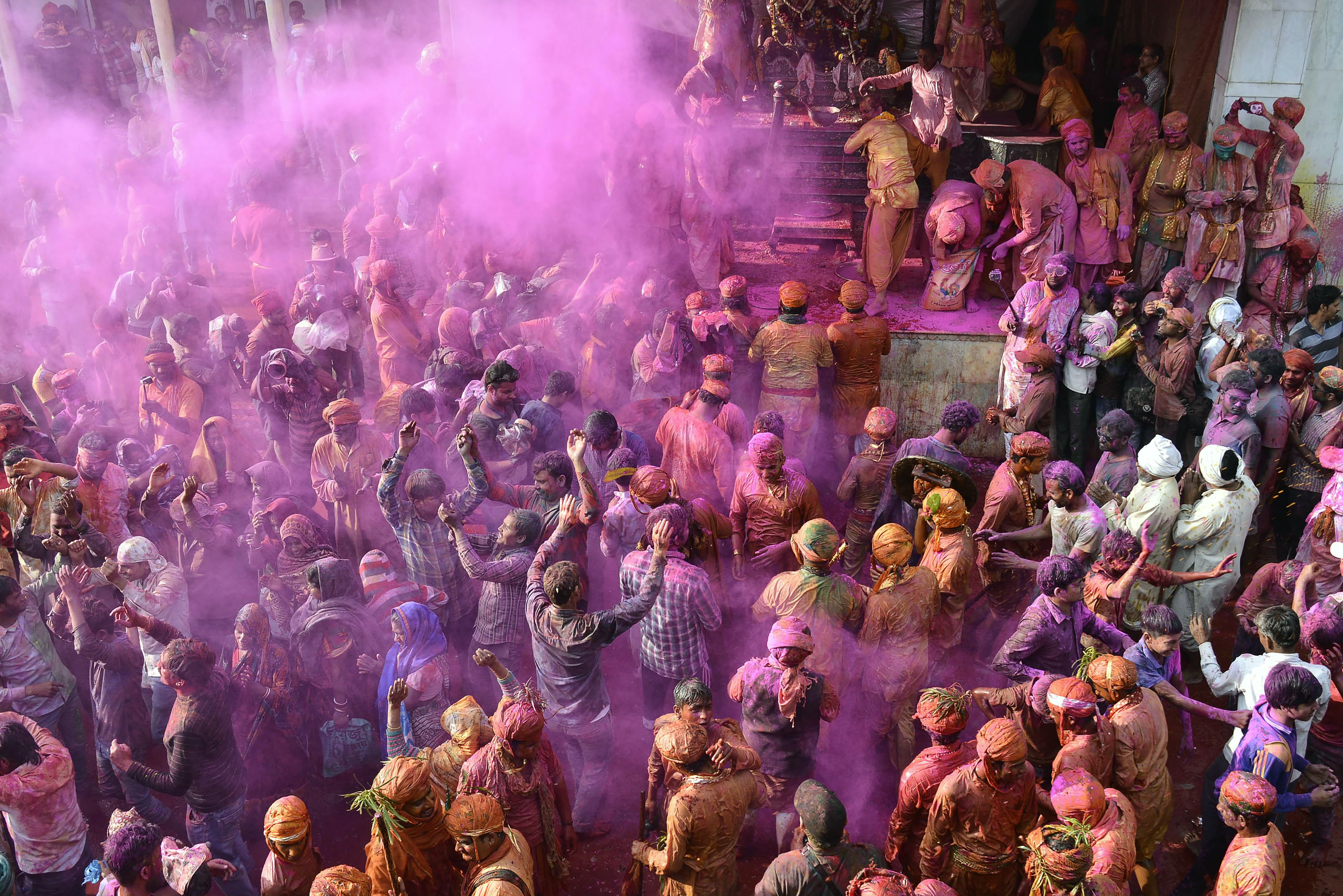 Indian Hindu devotees celebrate Holi, the spring festival of colours, during a traditional gathering at Nandgaon village in Uttar Pradesh state on March 7, 2017.