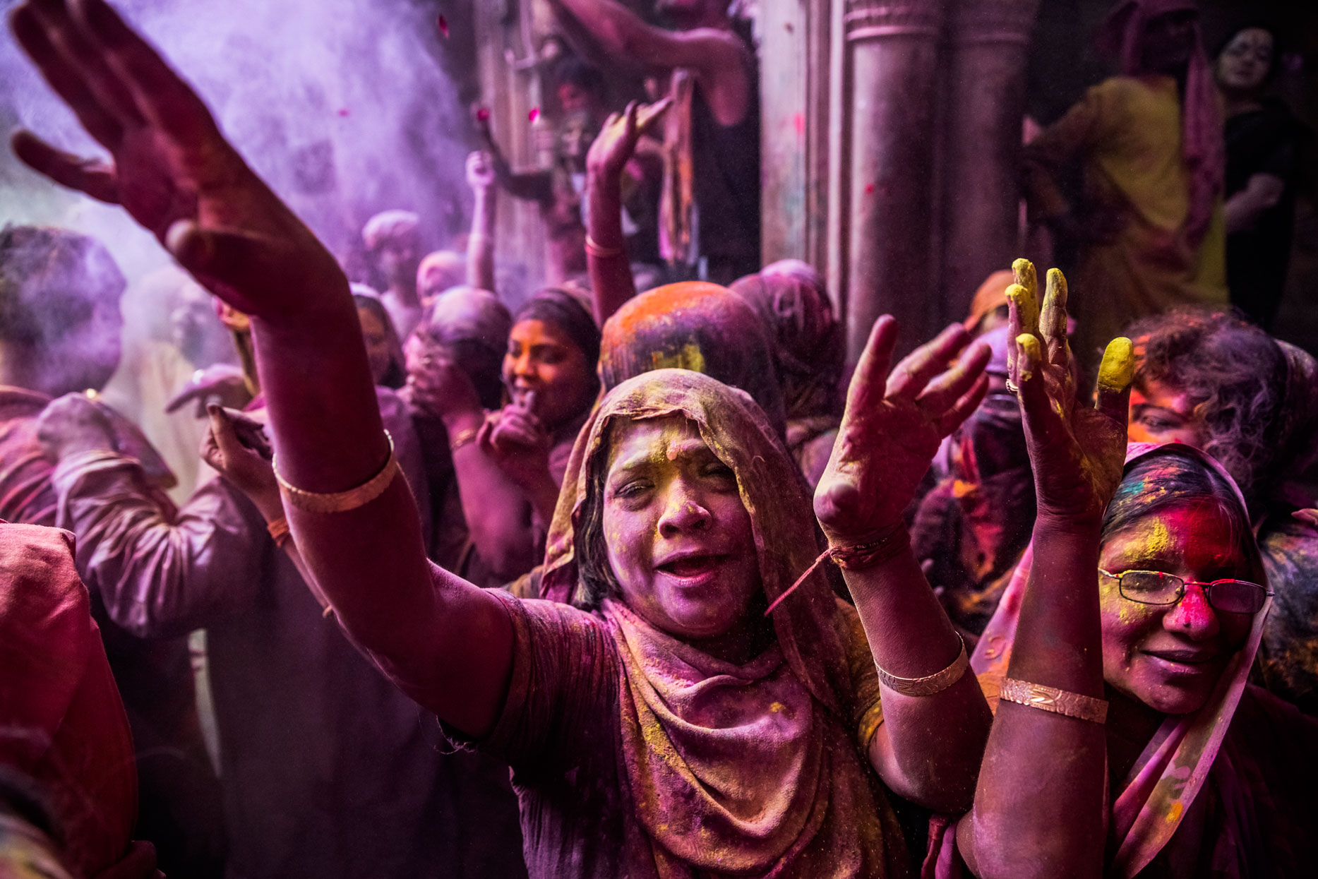 Hindu devotees play with colour during Holi celebrations at the Banke Bihari temple on March 27, 2013 in Vrindavan, India.