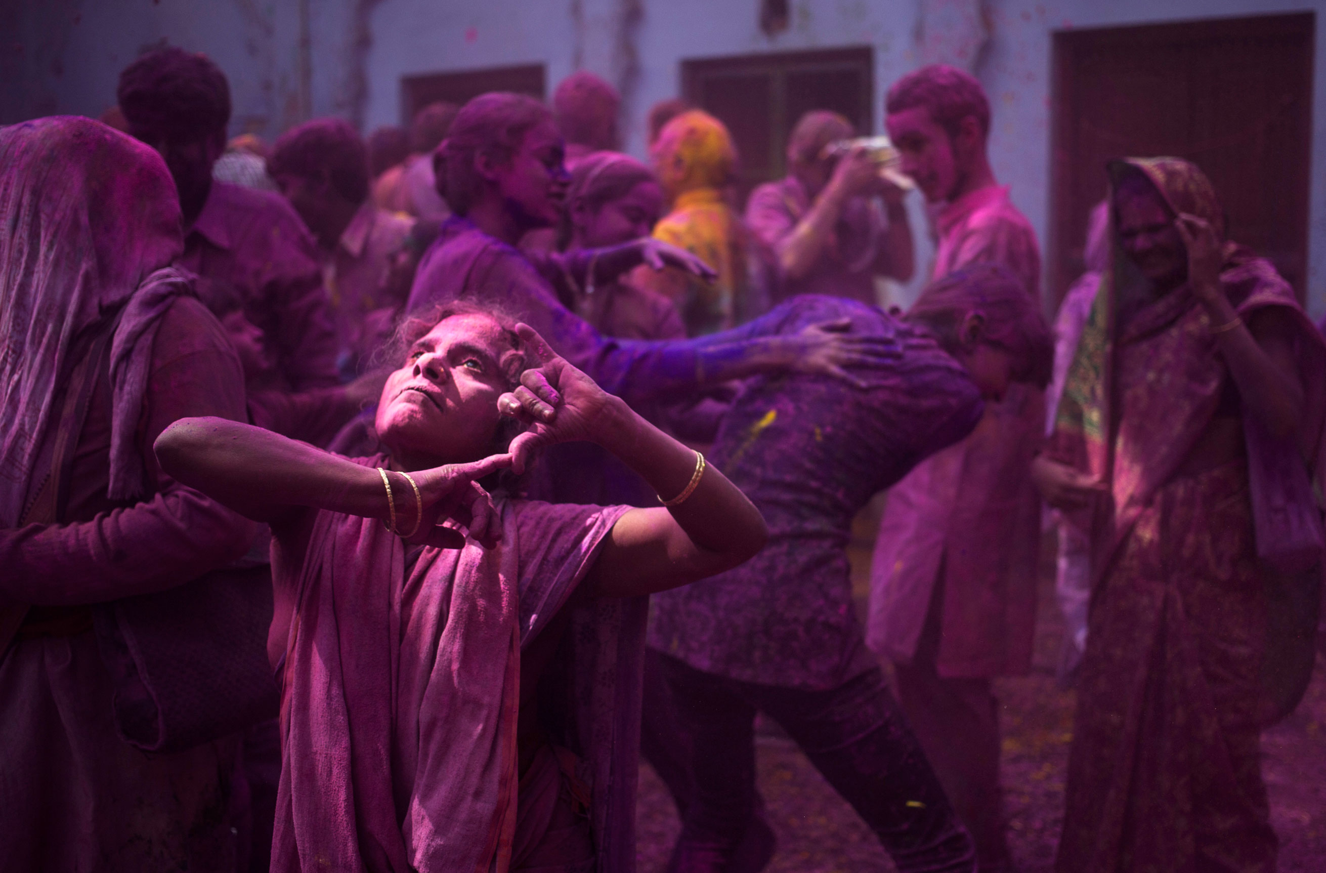Indian Hindu widows and others play with colored powder as part of Holi celebrations at the  Meera Sahabhagini Widow Ashram in Vrindavan, on March 3, 2015.