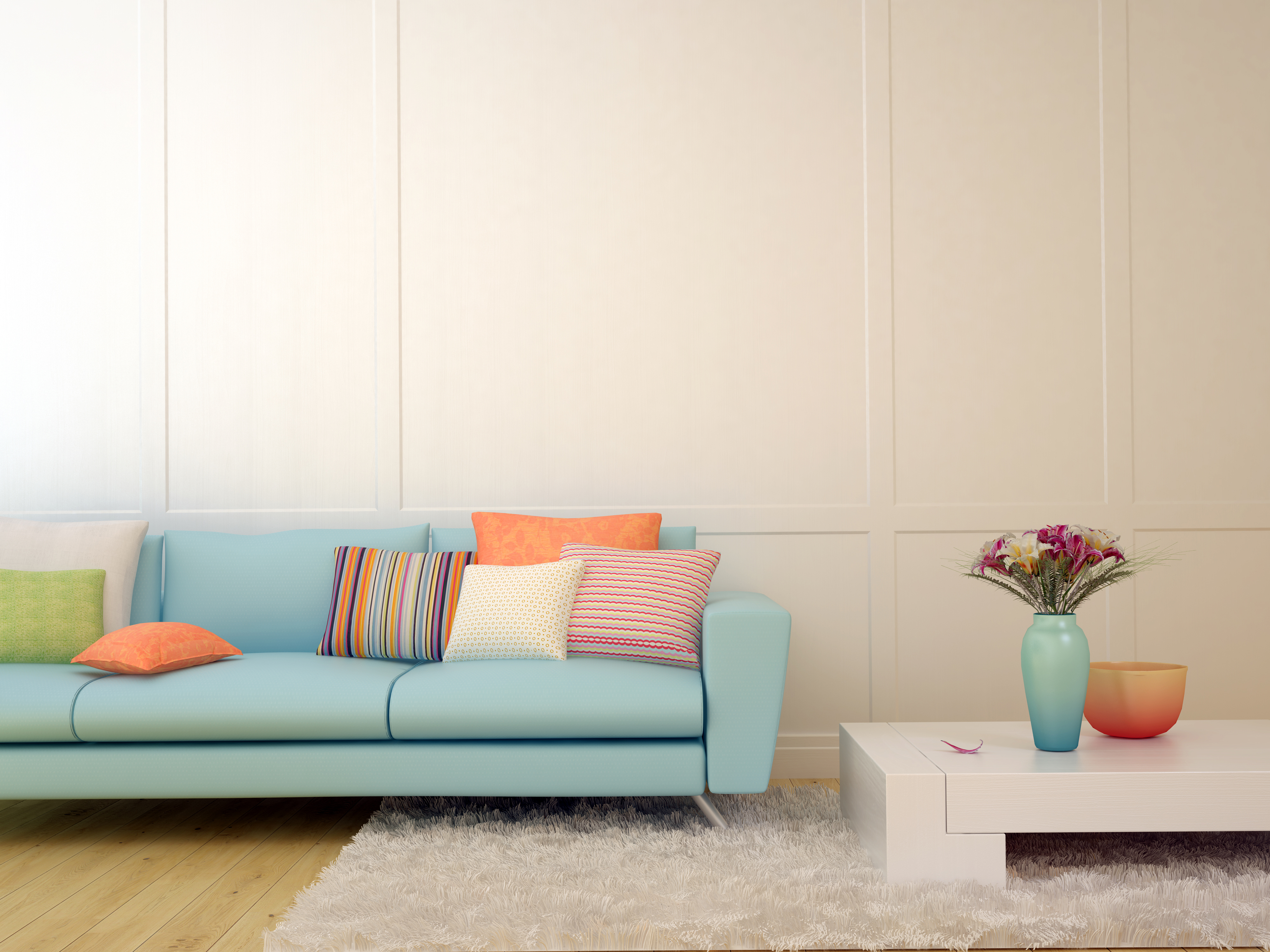 Bright composition of a light blue sofa with cushions  and a white table on the white carpet