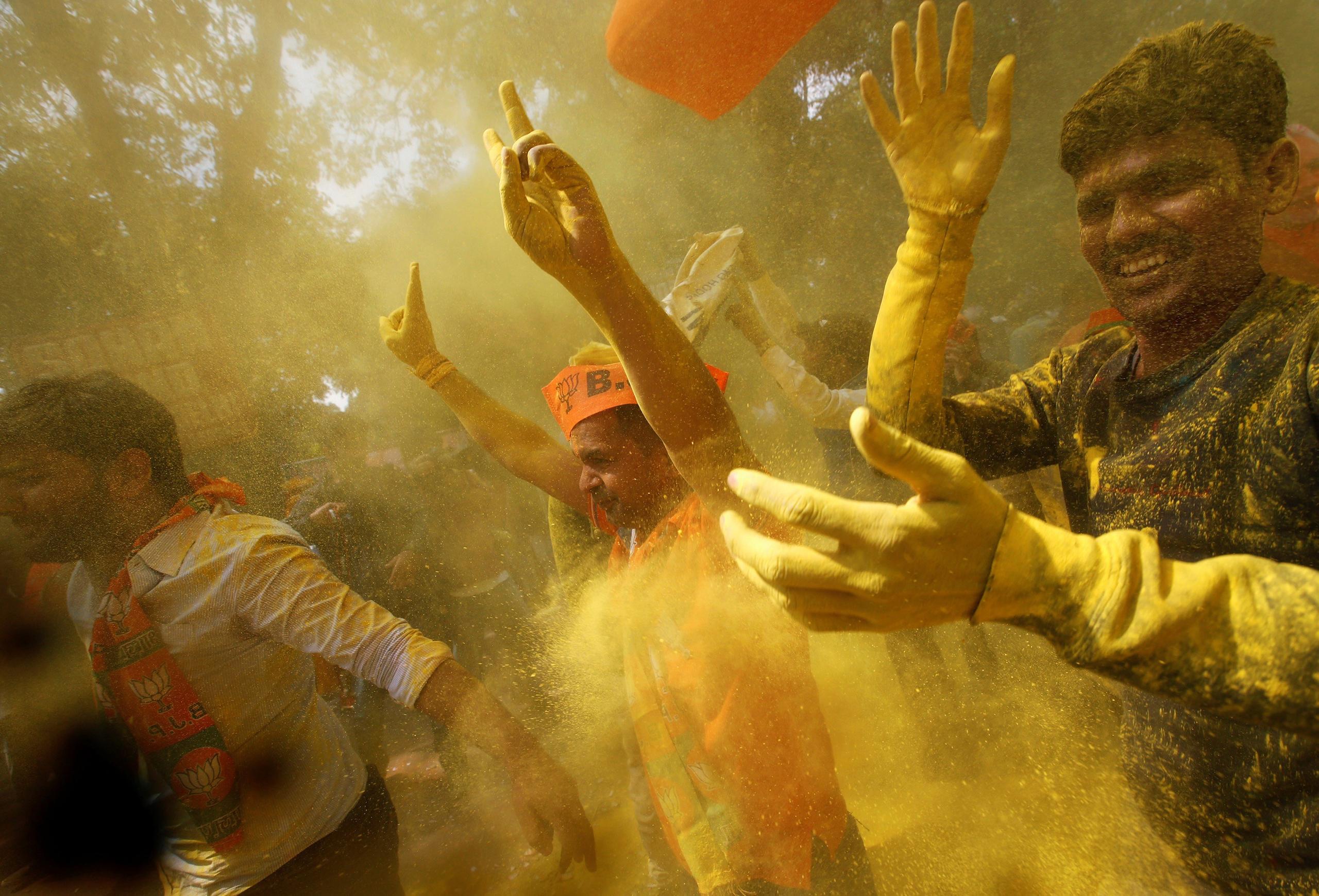 Modi's supporters in New Delhi celebrate his big victory in crucial Uttar Pradesh.
