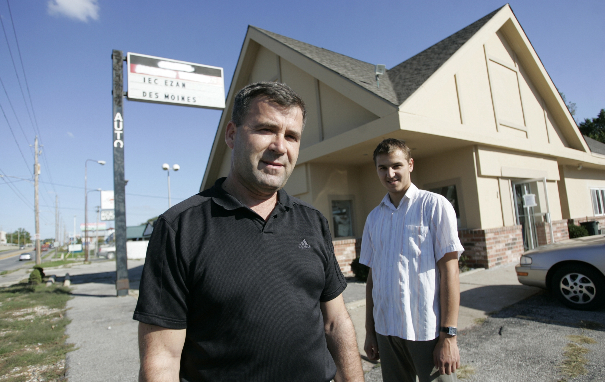 Nihat Rahic,of West Des Moines, and Emir Huskanovic, of Bosnia, right, stand in front of the new Islamic Education Center in Des Moines, Iowa on Sept. 18, 2008.
