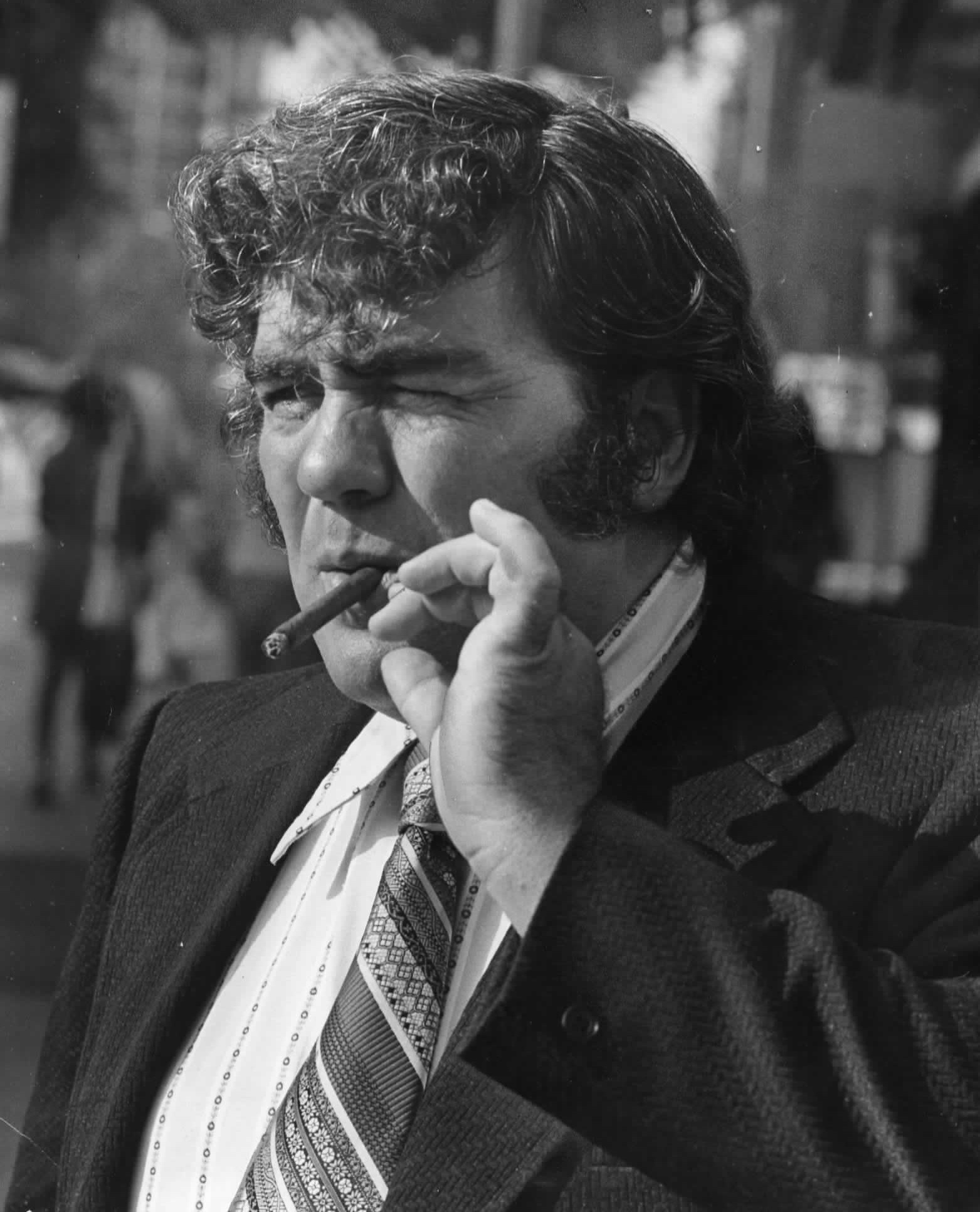 Writer Jimmy Breslin smokes a cigar outside the Madison Hotel in Washington, D.C. on Aug. 29, 1973.