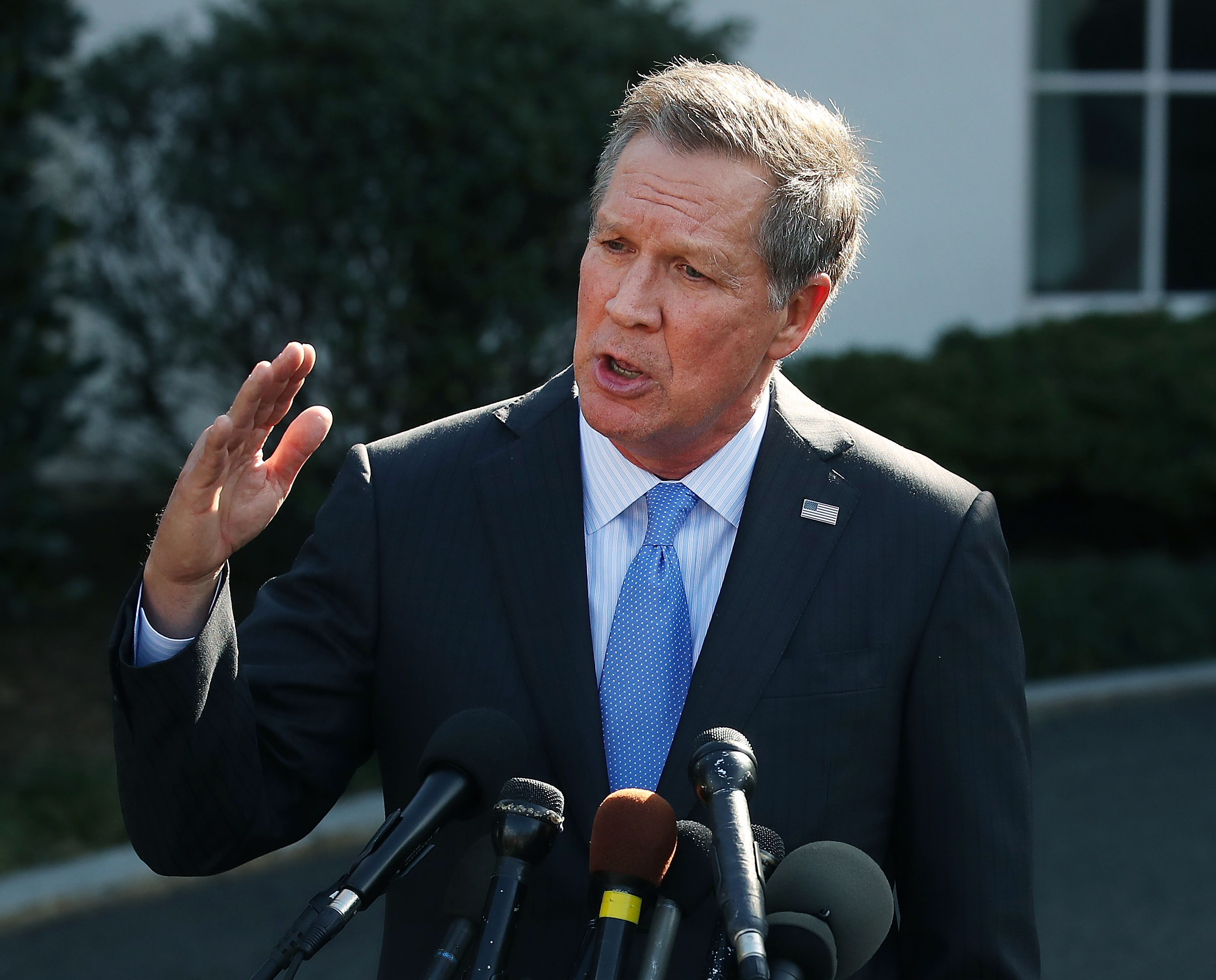 Ohio Governor John Kasich speaks to reporters after a closed meeting with U.S. President Donald Trump, on Feb. 24, 2017 in Washington, D.C.
