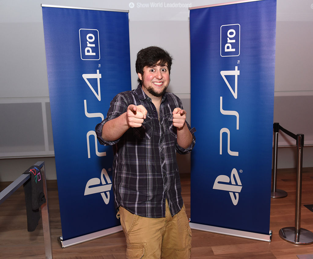 Jonathan Jafari aka JonTron celebrates at the PlayStation 4 Pro midnight launch event at Sony Square NYC on November 9, 2016 in New York City.