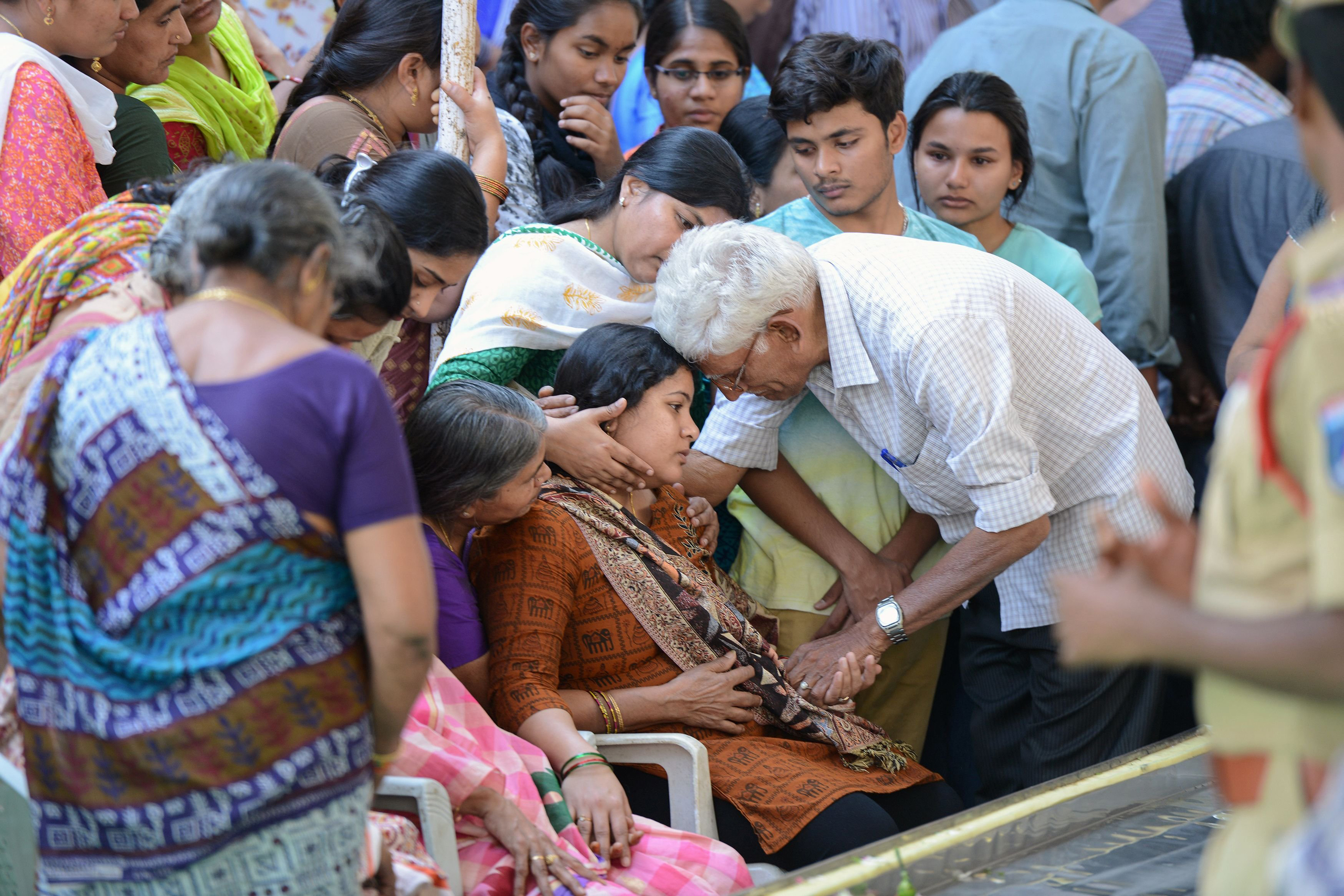 Sunayana Dumala, wife of the Indian engineer, Srinivas Kuchibhotla, who was shot dead in a Kansas bar, is consoled by family members at his funeral in Hyderabad on Feb. 28, 2017.