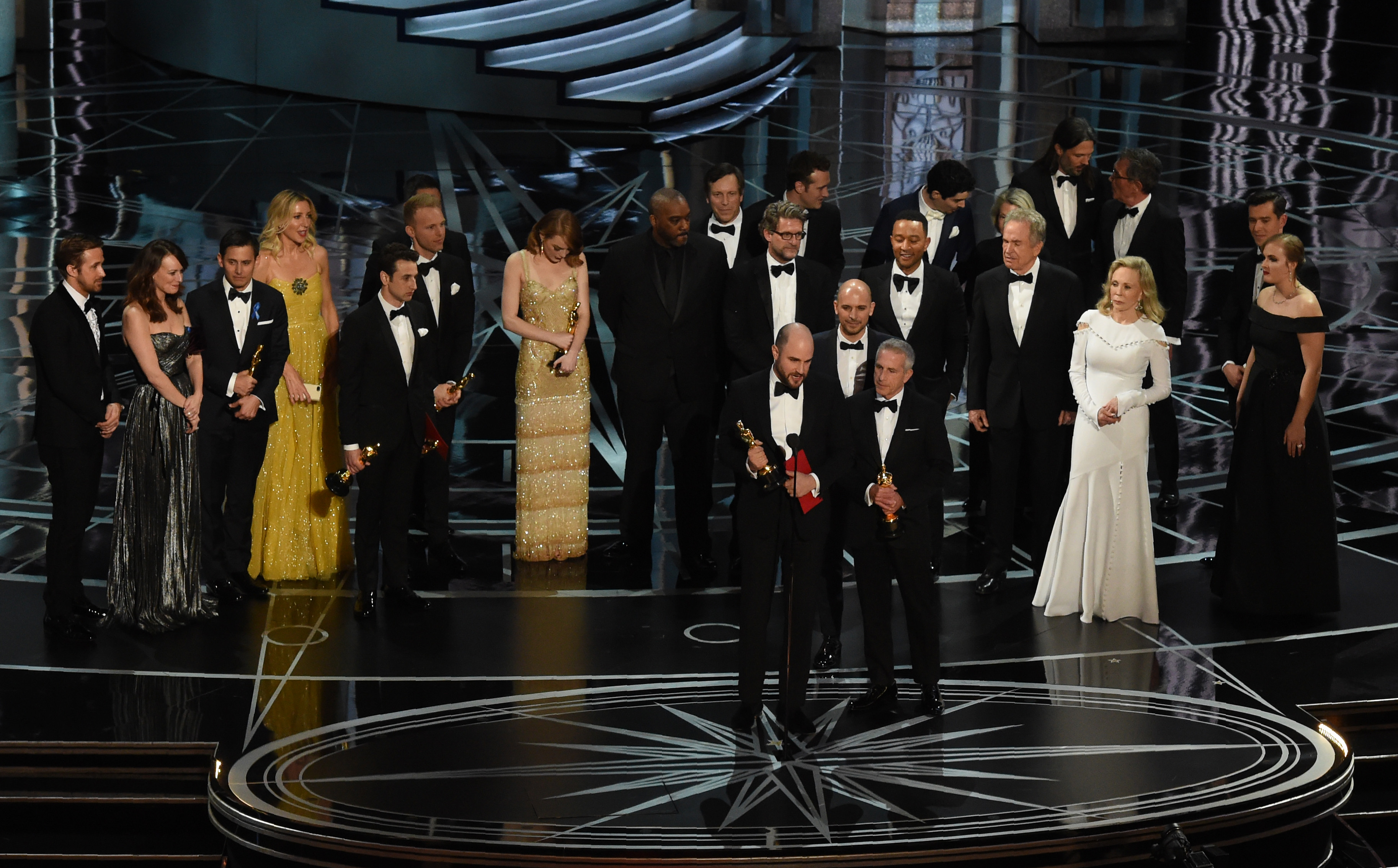 'La La Land' producer Jordan Horowitz (C) speaks while holing an oscar and the winner card before reading the actual Best Picture winner 'Moonlight' onstage during the 89th Oscars on February 26, 2017 in Hollywood, California
