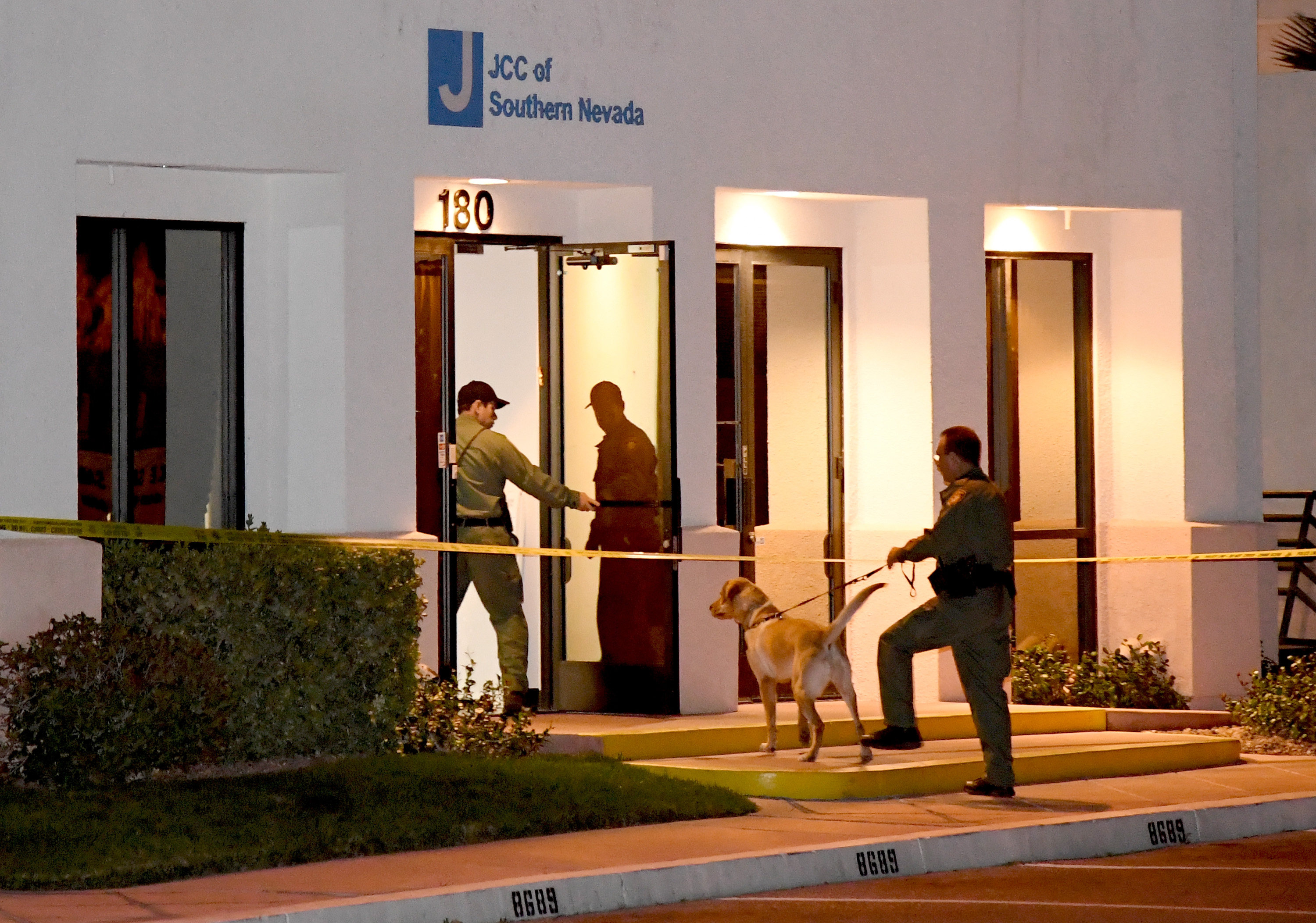Police officers search the Jewish Community Center of Southern Nevada after an employee received a suspicious phone call that prompted an evacuation on February 26, 2017 in Las Vegas, Nevada.
