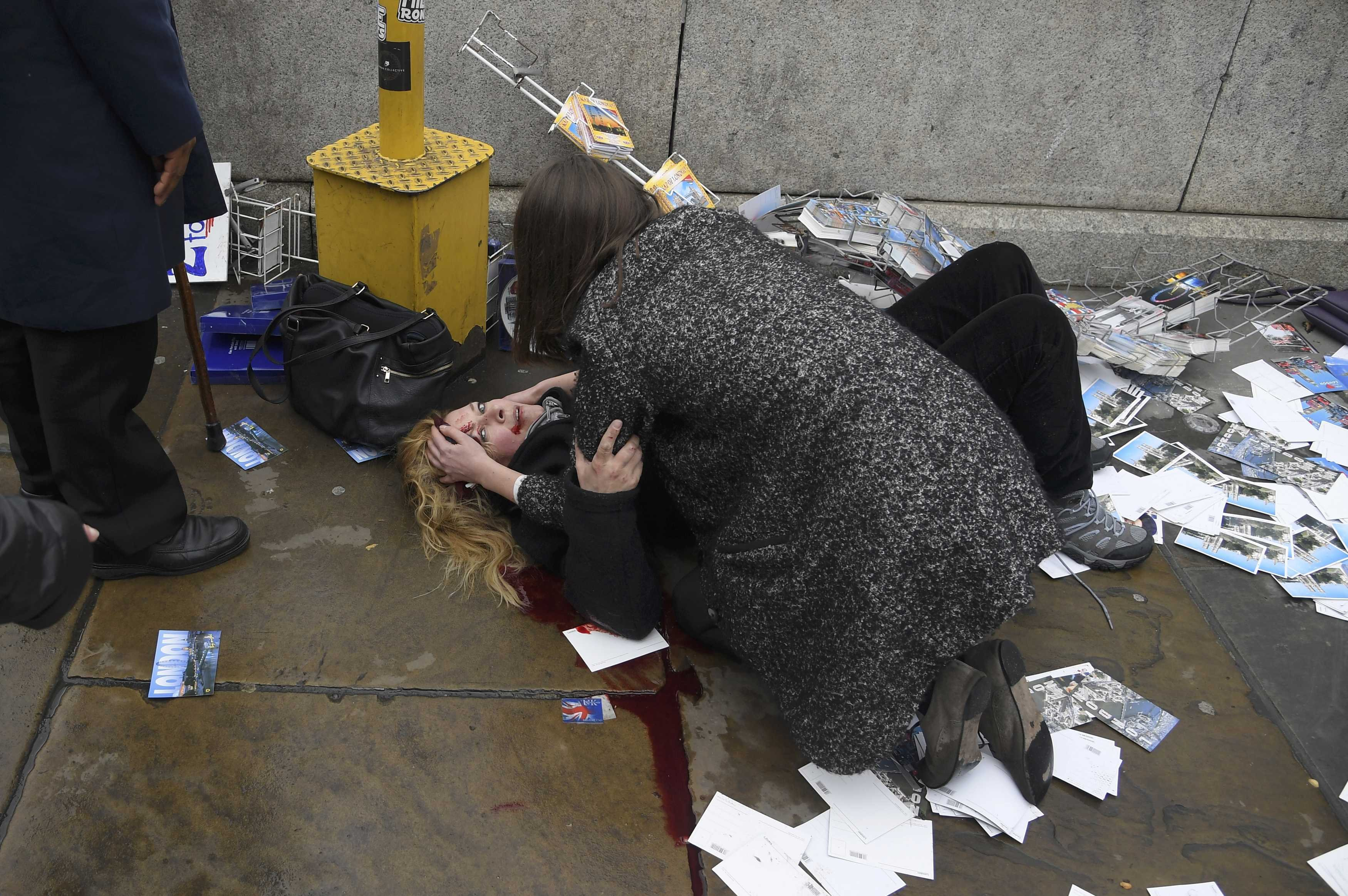A woman lies injured after a shotting incident on Westminster Bridge, on March 22, 2017.