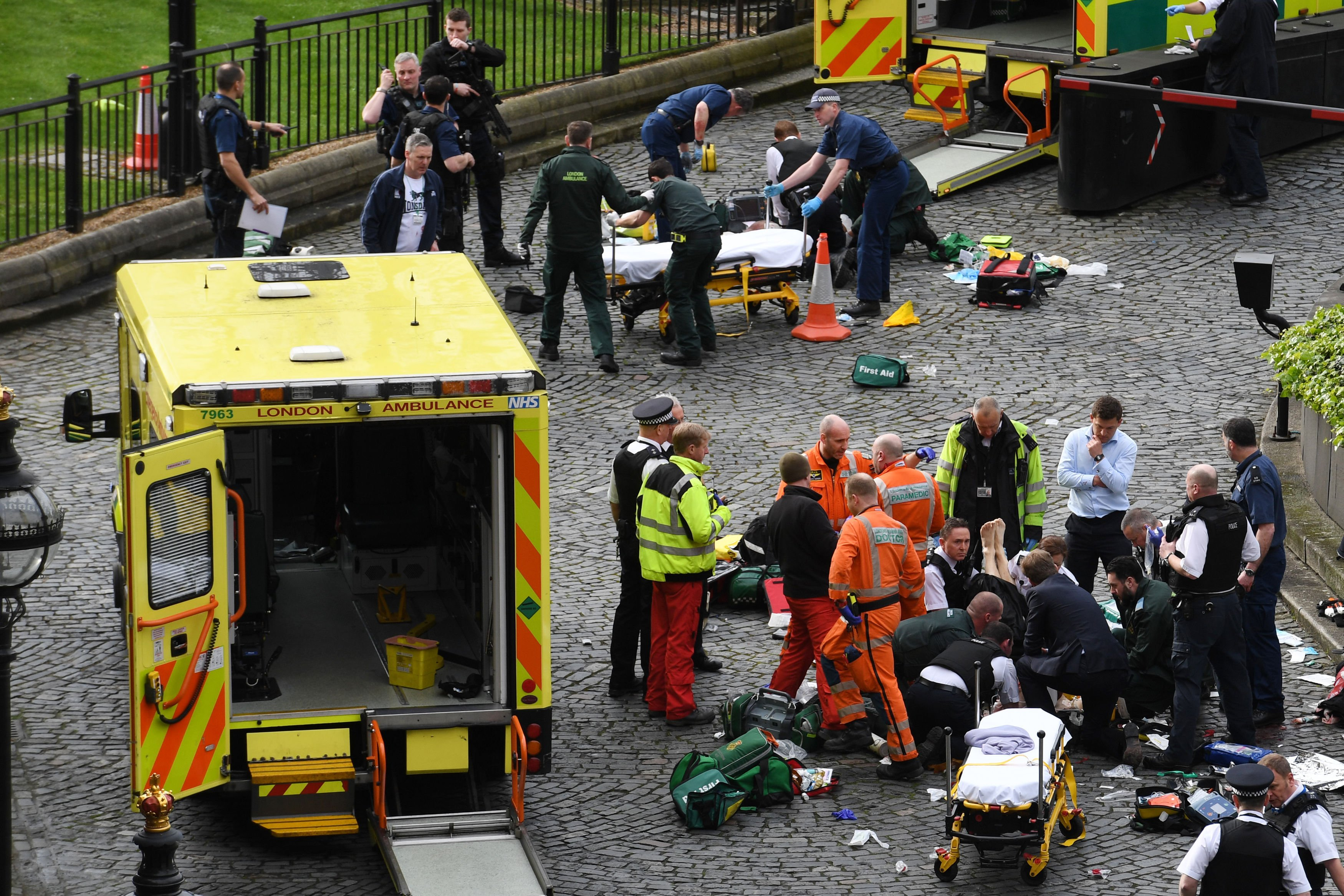 Emergency services at the scene outside the Palace of Westminster after a policeman was stabbed and the apparent attacker was shot by officers at the Houses of Parliament in London on March 22, 2017.