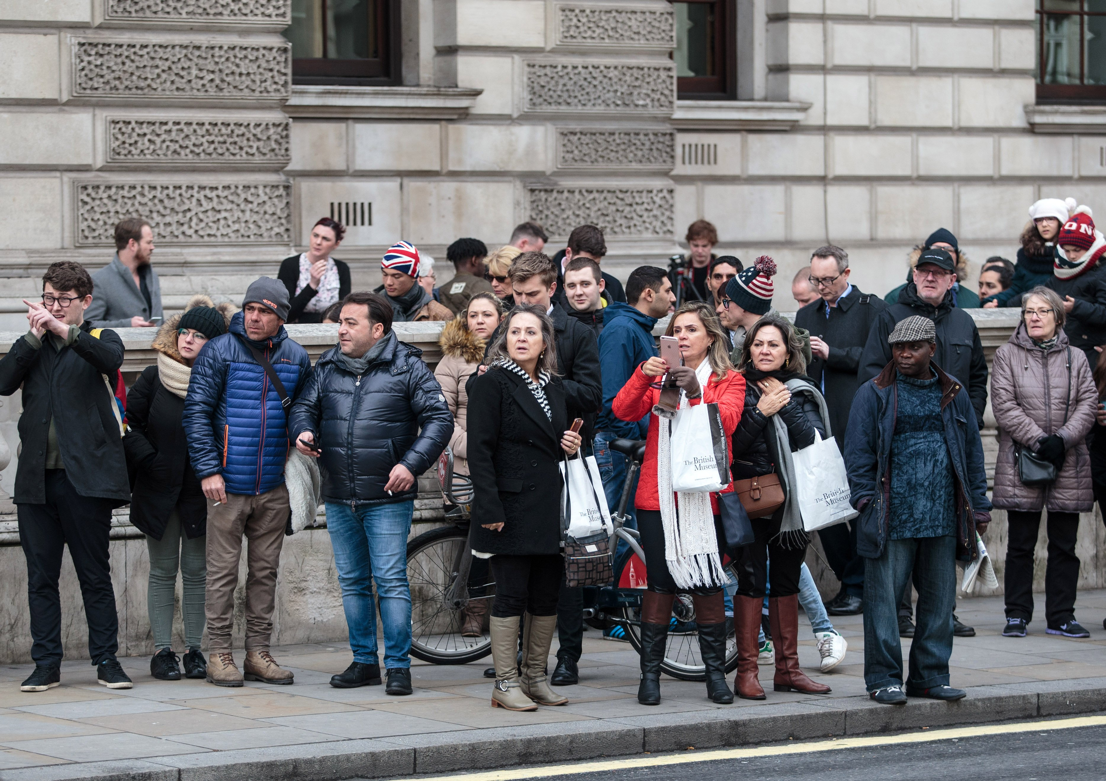 Members of the public look on as roads are closed off by Police around Westminster Bridge and the Houses of Parliament on March 22, 2017.