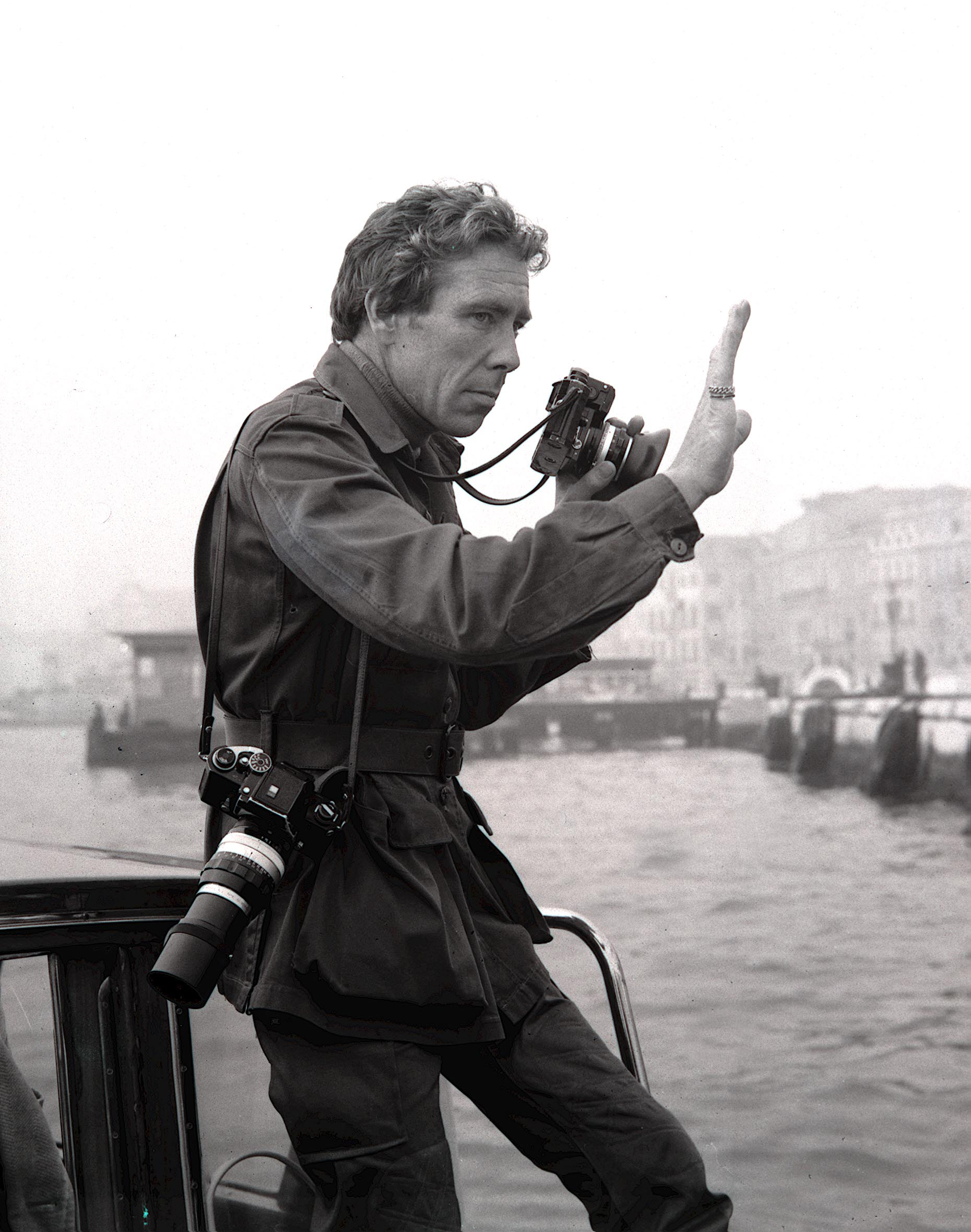 Photographer Lord Snowdon, husband of Princess Margaret, pictured at work in Venice, Italy on Oct. 14, 1971.
