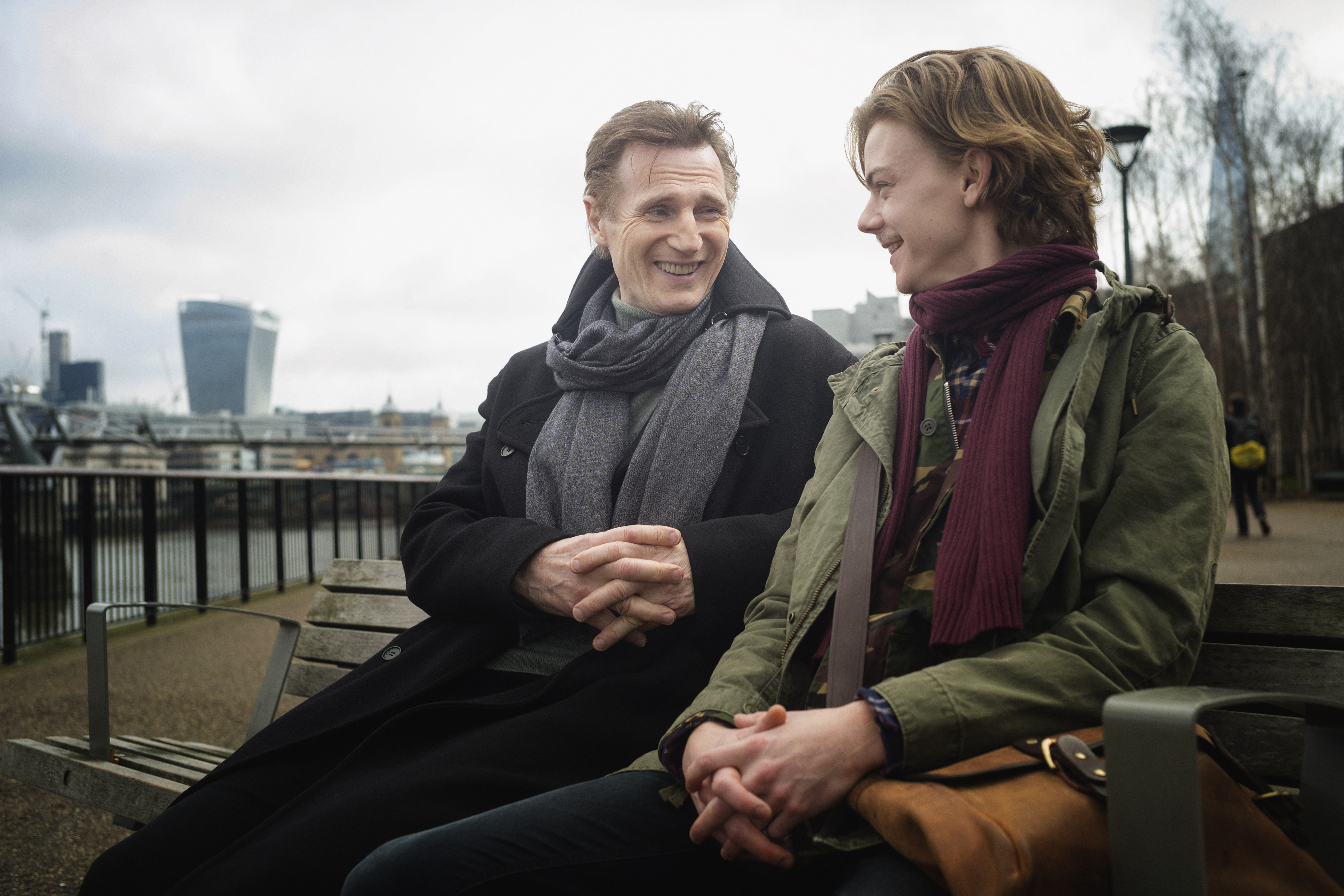 In this handout image provided by Comic Relief, Liam Neeson as Daniel and Thomas Brodie-Sangster as Sam record a film for 'Red Nose Day Actually' on Febuary 16, 2017 in London. (Photo by Sarah M Lee/Comic Relief via Getty Images)