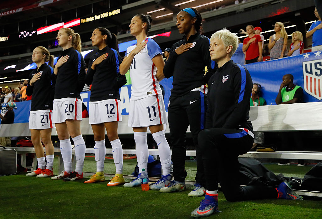 Megan Rapinoe #15 kneels during the National Anthem prior to the match between the United States and the Netherlands at Georgia Dome on September 18, 2016 in Atlanta, Georgia.
