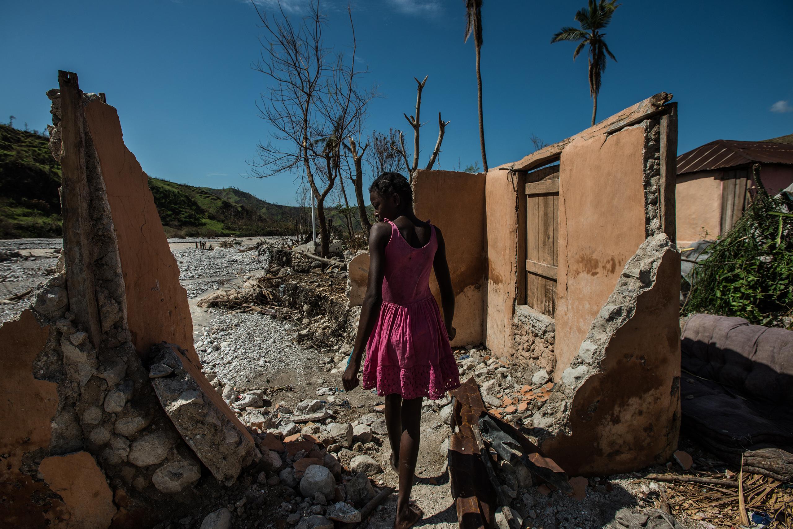A girl walks through destroyed homes in Rendel, a village in Haiti devastated by Hurricane Matthew, on Oct. 12, 2016.