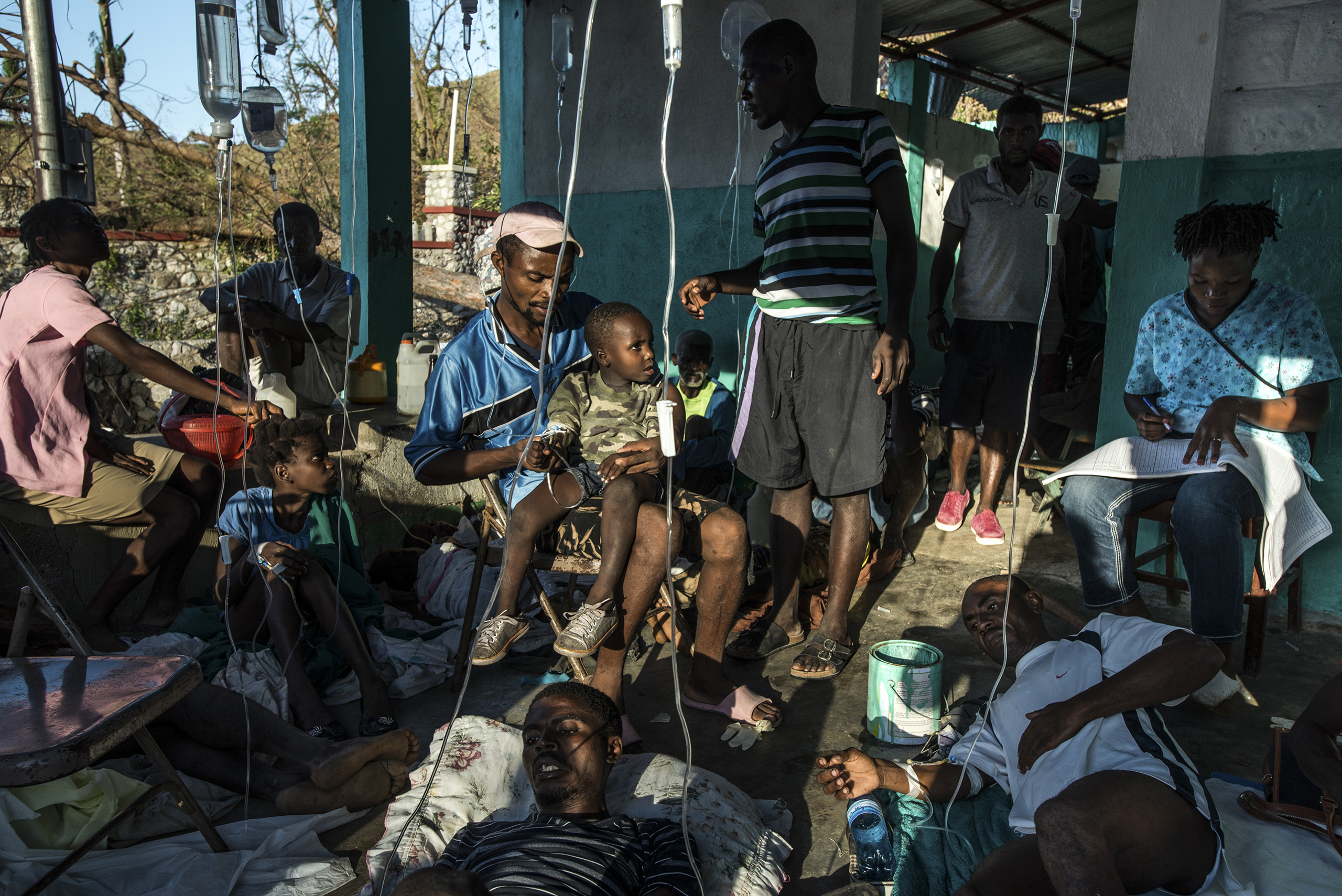 Patients with symptoms of cholera with their families, who risk getting sick caring for their loved ones, at a small clinic in Rendel, Haiti, on Oct. 12, 2016. The town of Rendel and its surroundings, which once sheltered 25,000 people, are the epicenter of a potential Cholera disaster in Haiti made worse by the recent destruction caused by the storm.
