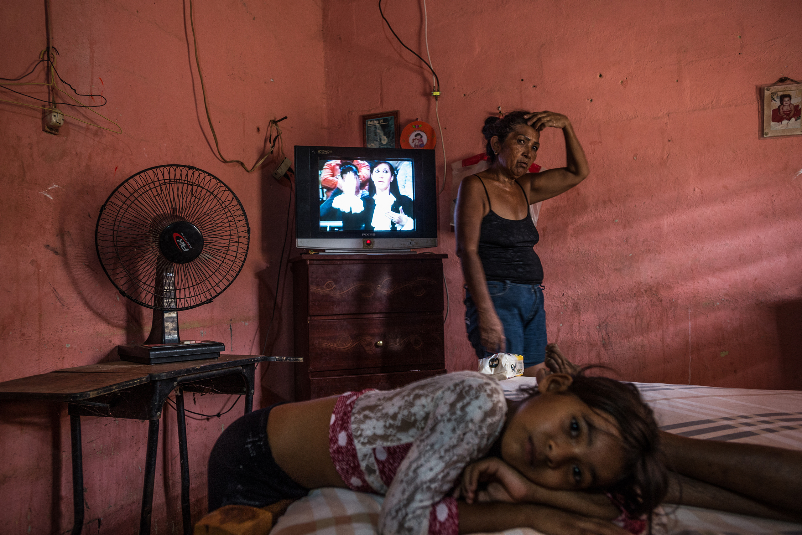 Minerba Pinera with her granddaughter Karla in La Vela, Venezuela, on Sept. 11, 2016. The country's economic crisis left the family struggling to find the medicine Pinera's mother needed to treat her diabetes.