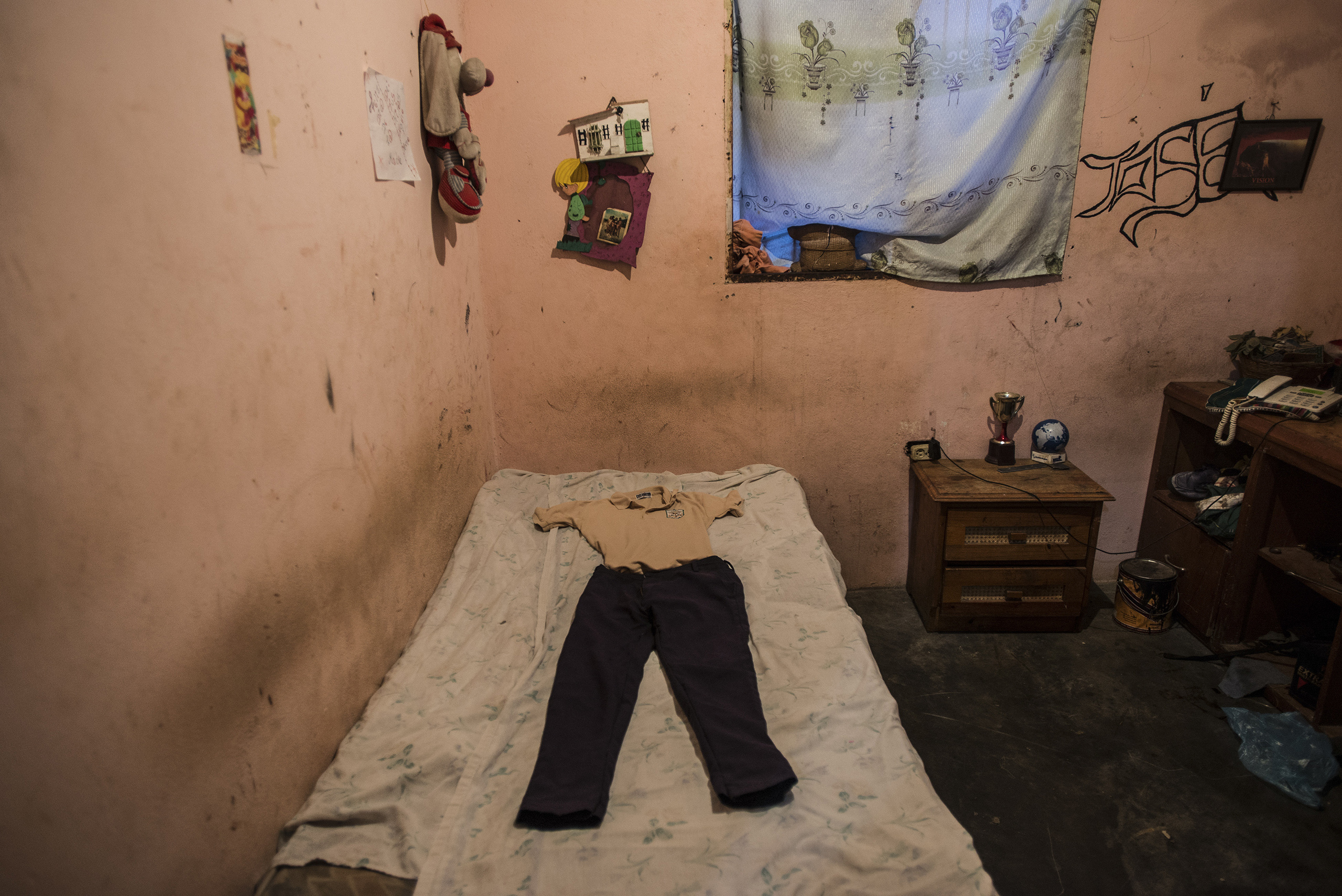 Kevin Lara Lugo's school uniform on his bed in Maturin, Venezuela, on Sept. 5, 2016. After not having eaten in three days, the 16-year-old died after he was poisoned by foraged yucca and taken to a hospital that had no supplies.
