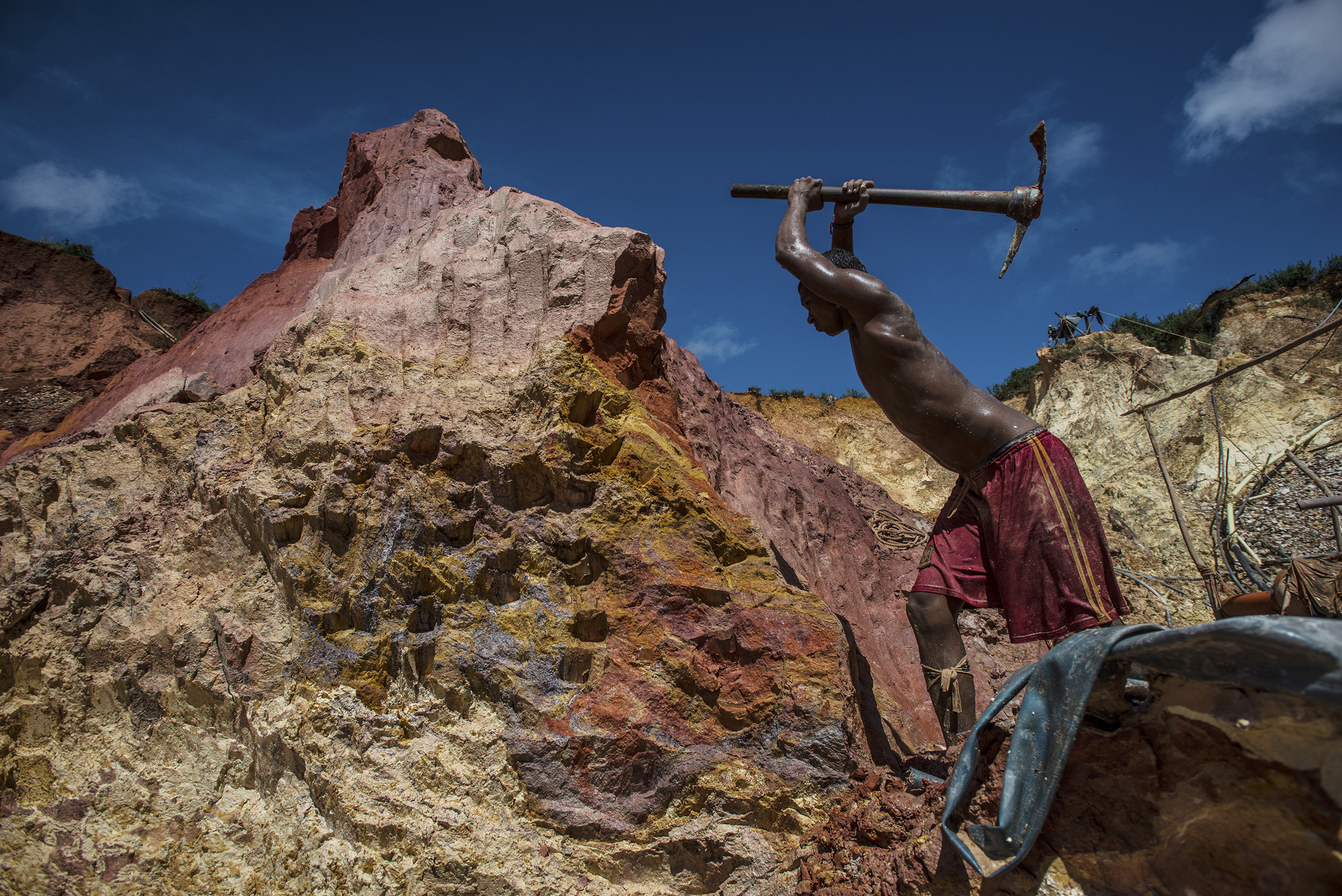 Carlos Freydel mines for gold at the illegal  Cuatro Muertos  mine outside Las Claritas, Venezuela, on July 20, 2016. The cratered economy has sent many Venezuelans to work in the country's illegal gold mines scattered across the jungle, where the primitive conditions have seen malaria return with a vengeance.