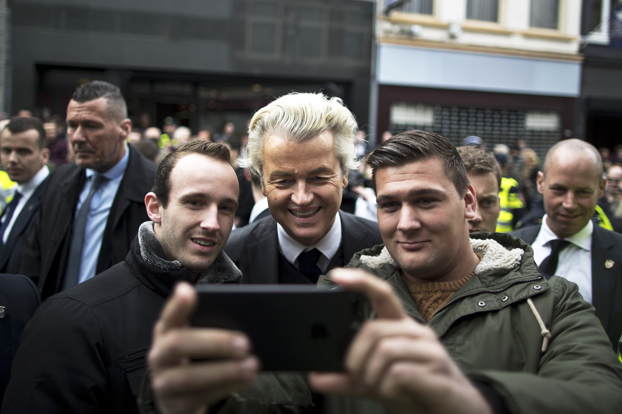 Firebrand anti-Islam lawmaker Geert Wilders, poses for a selfie with supporters during a campaign stop in Heerlen, Netherlands, on March 11, 2017.
