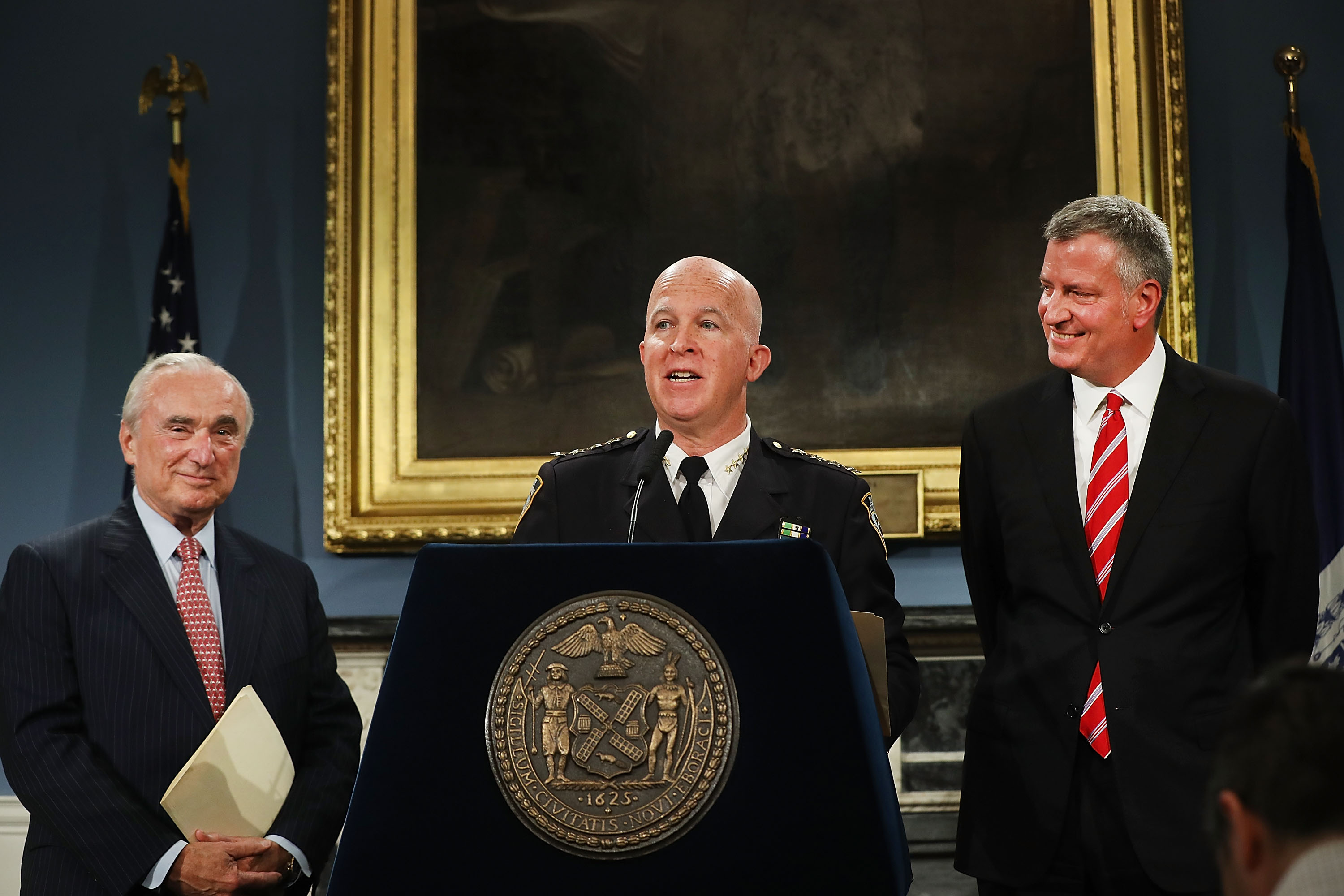 James O'Neill stands with former New York City Police Commissioner Bill Bratton (left) and Mayor Bill de Blasio at a news conference where it was announced that Bratton was stepping down and O'Neil would take over as Commissioner on August 2, 2016 in New York City.