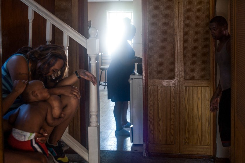 USA. Detroit, MI. 2012. Treasure's family at their home in Detroit. Shelley 'Treasure' Hilliard was murdered by a drug dealer after acting as a police informant following an arrest for marijuana possession. The police convinced her to act as an informant on her dealer and after she set him up, the police arrested him. They allegedly leaked her name to him for unclear reasons and released him several hours later. Within hours, Treasure was dead. Her case is part of a rash of murders of police informants as law enforcement increasingly relies on their use to apprehend criminals without exercising due diligence to protect them from revenge killings.