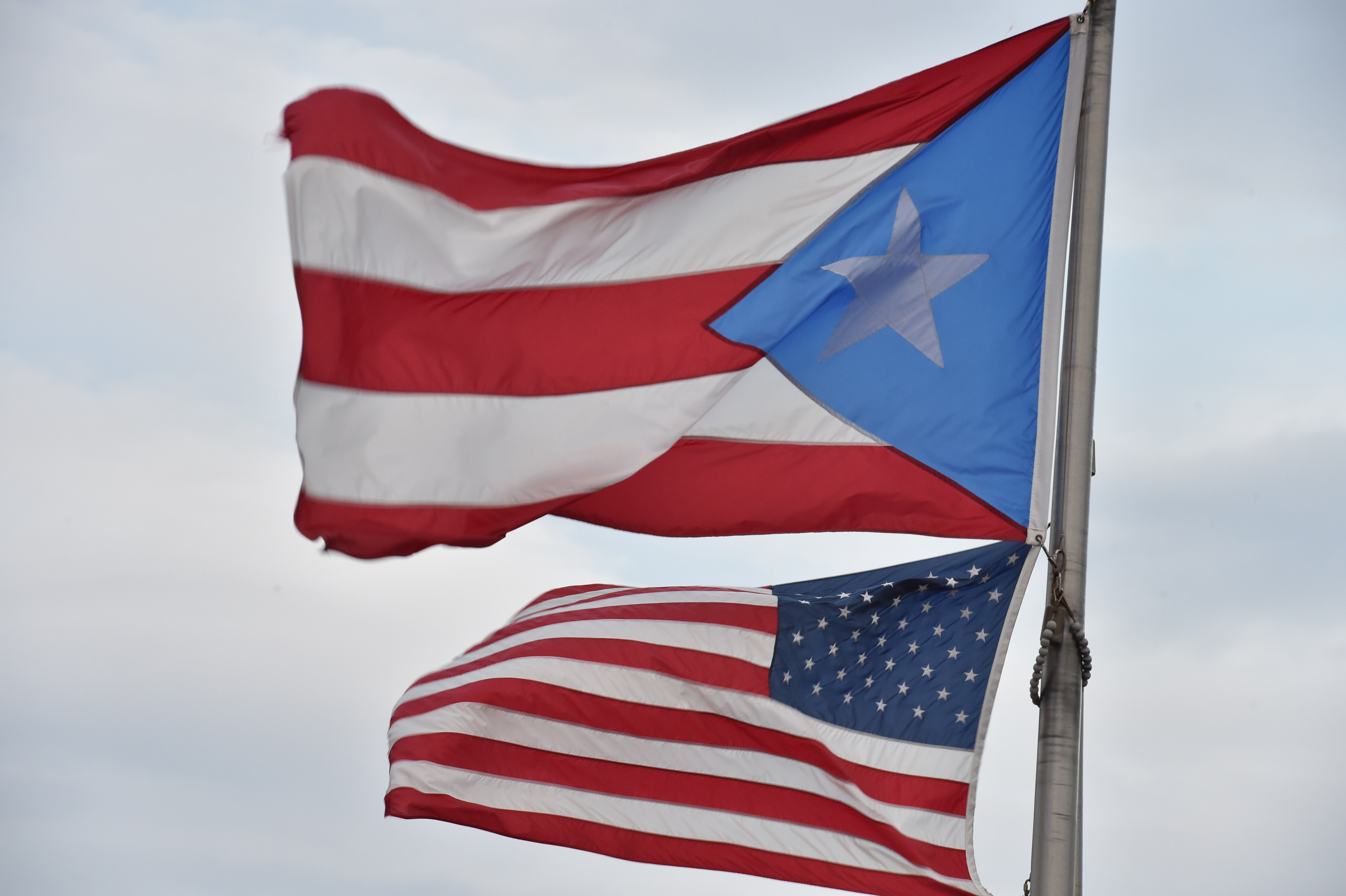 The Puerto Rican and US flags are seen in the Old Town  district  Feb. 9, 2015  in San Juan, Puerto Rico.