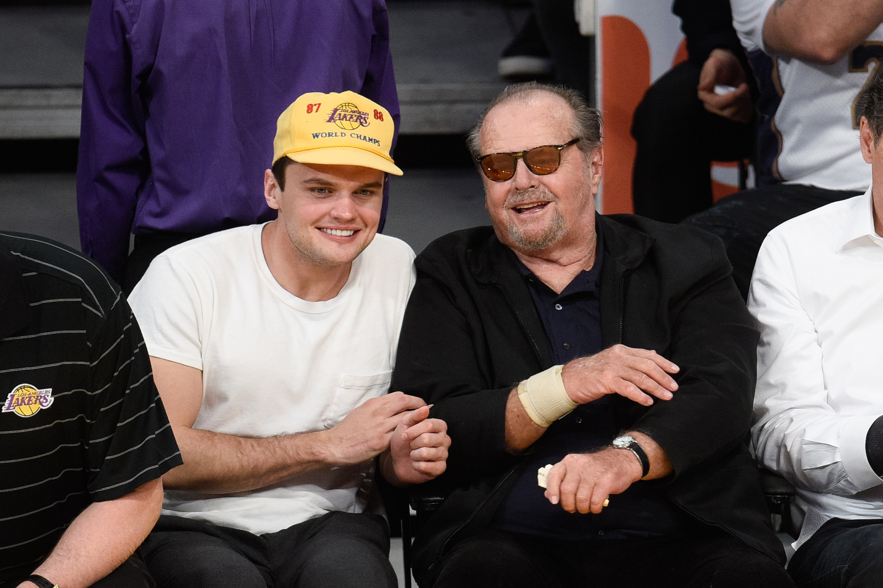 Jack Nicholson (R) and Ray Nicholson attend a basketball game between the Golden State Warriors and the Los Angeles Lakers at Staples Center on March 6, 2016 in Los Angeles, California.