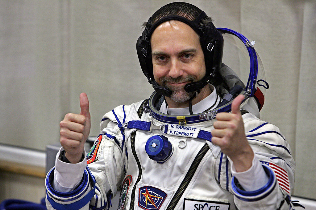 U.S. space tourist Richard Garriott gestures after putting on a space suit at the Baikonur cosmodrome, in Kazakhstan, on Oct. 12, 2008.