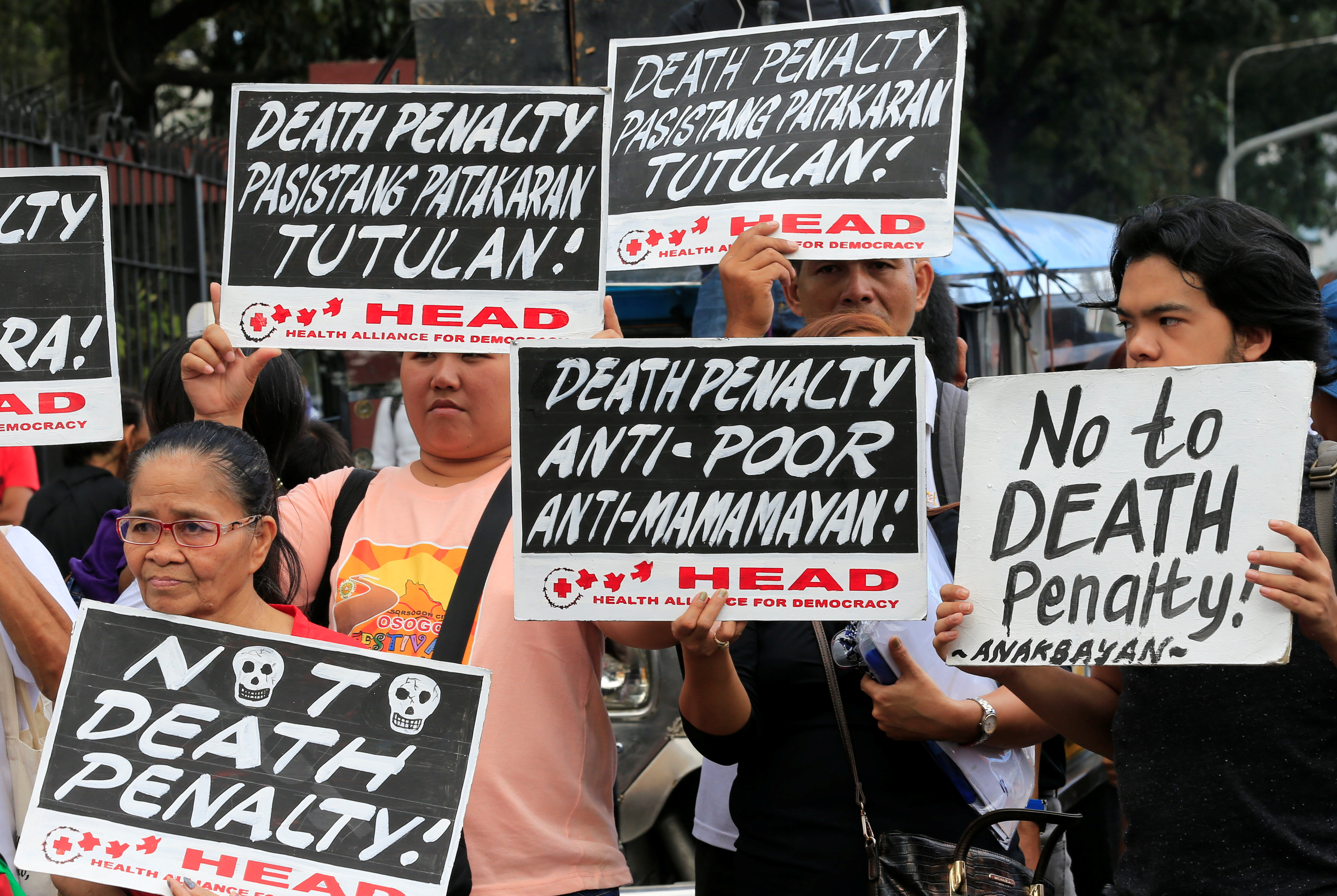Activists during a protest rally against the passing of the death penalty bill, in Quezon city, metro Manila, Philippines March 7, 2017.