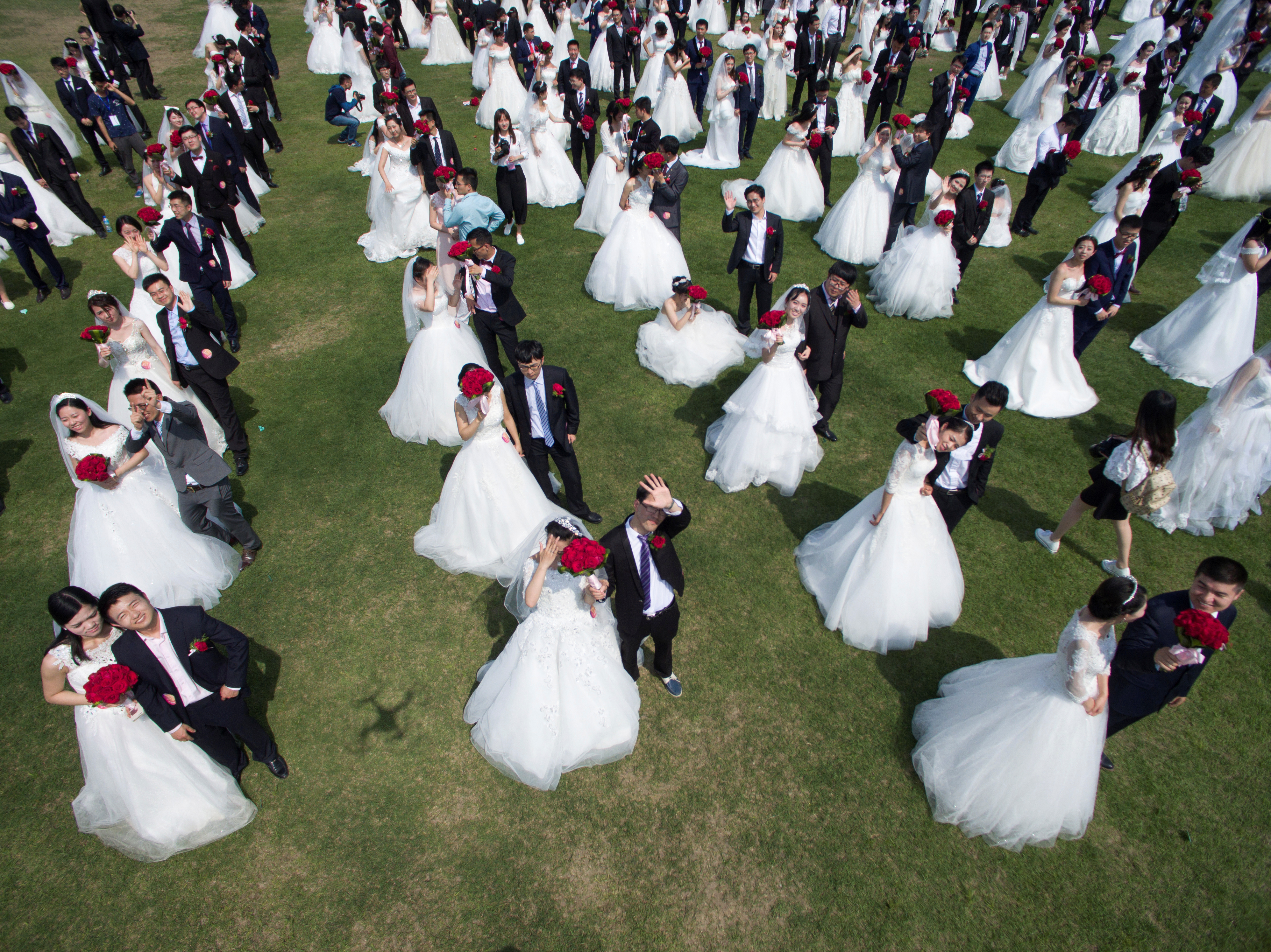 Newlywed couples attend a mass wedding ceremony in Hangzhou, Zhejiang province, China, on April 30, 2016