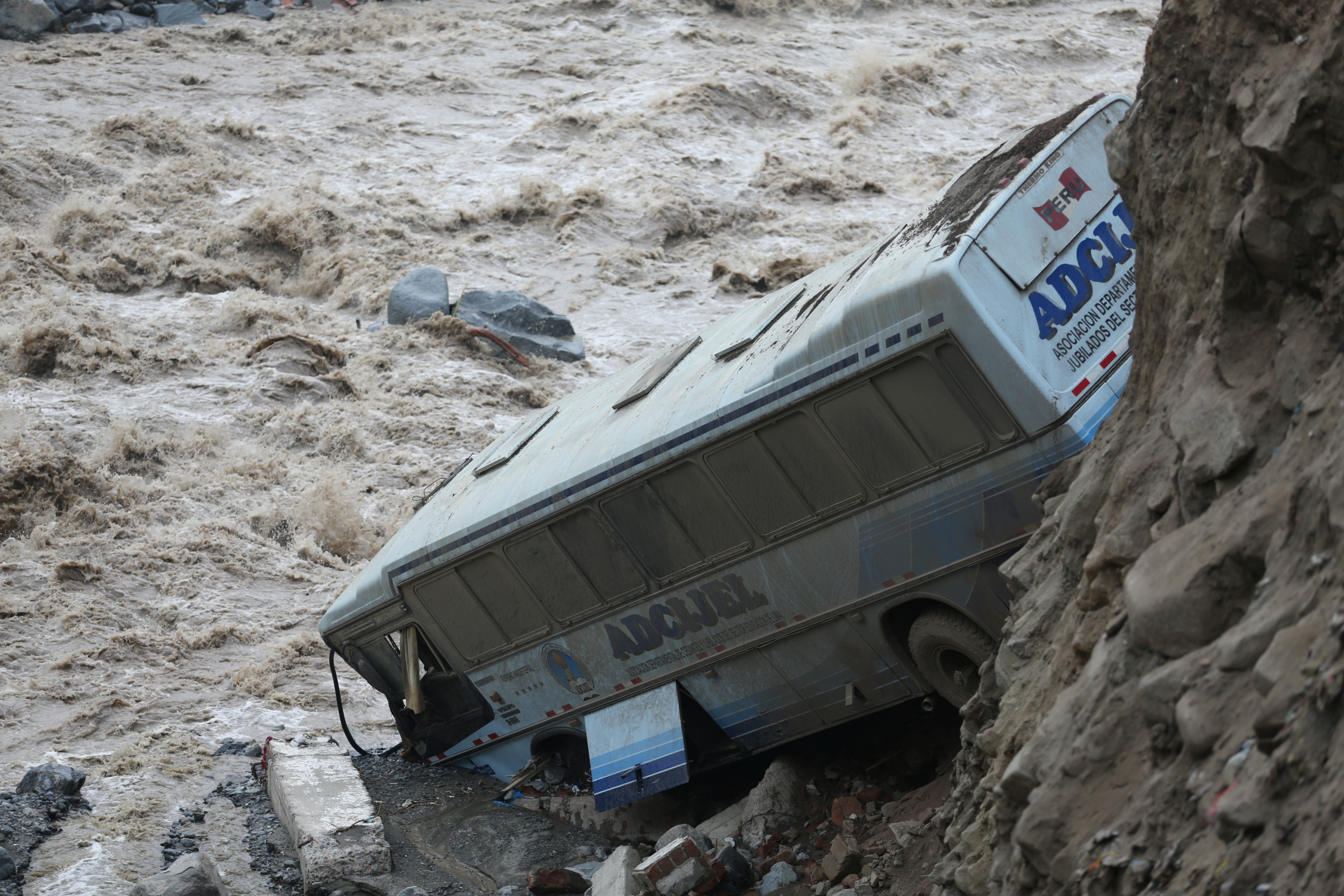 A bus is seen after a landslide and flood in Chosica, east of Lima, Peru March 16, 2017.