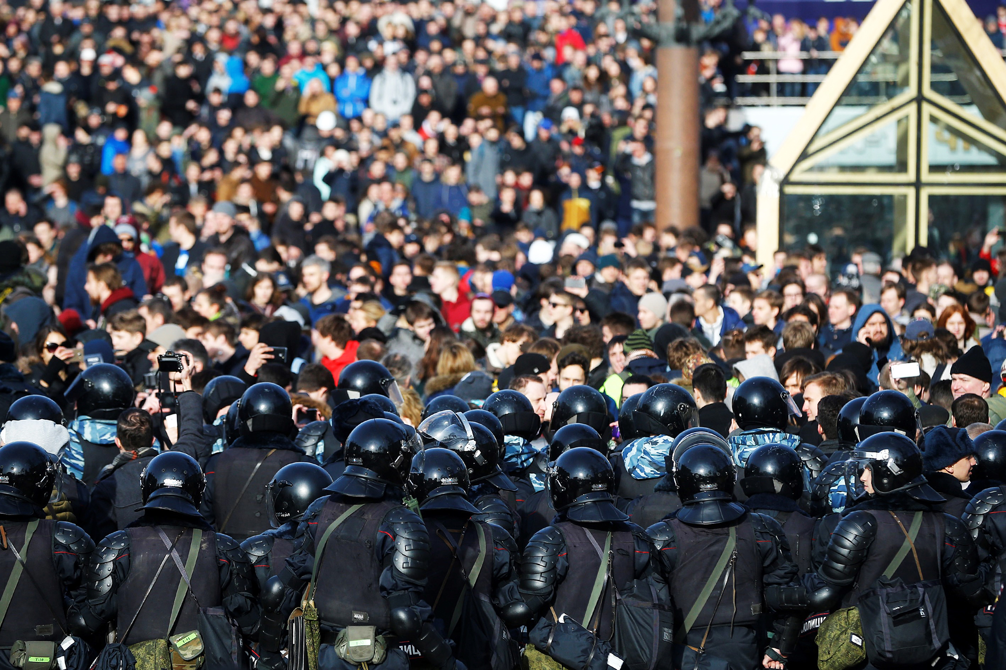Russian riot policemen stand guard as people take part in an opposition rally in Moscow, on March 26, 2017.