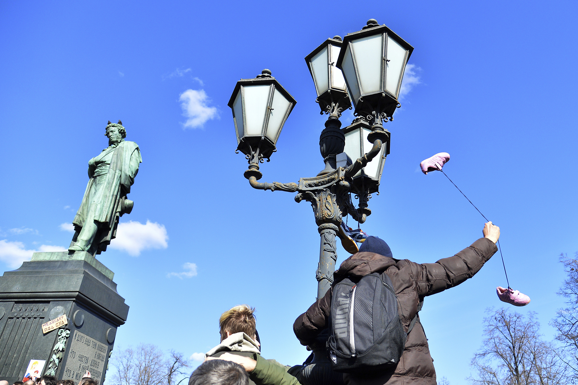 People hang trainers, which have become a symbol of corruption, from a lamppost in Moscow, Russia, on March 26, 2017.