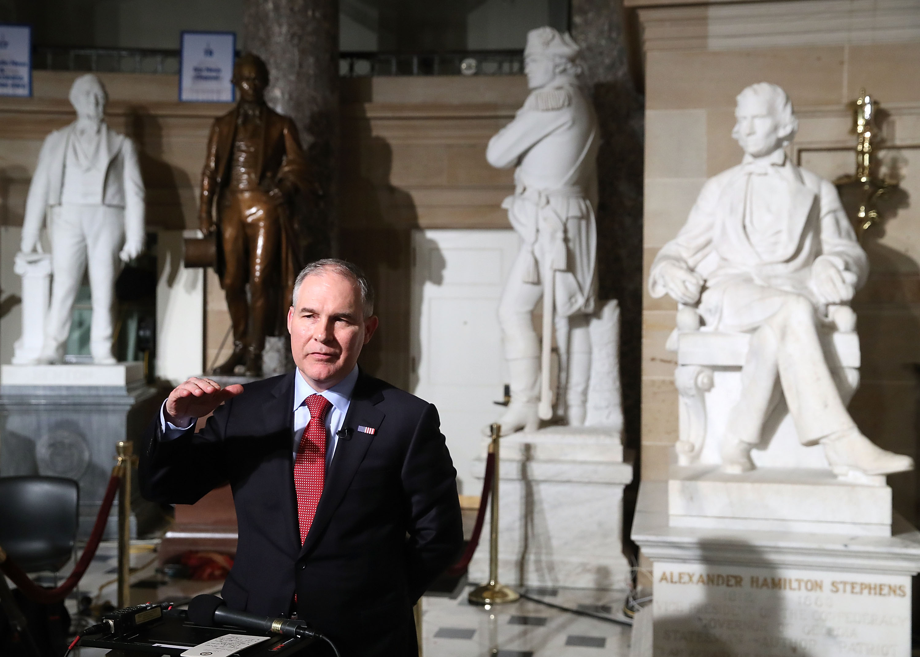 EPA Administrator Scott Pruitt does a television interview in Statuary Hall at the U.S. Capitol before President Donald Trump delivers a speech to a joint session of Congress on February 28, 2017 in Washington, D.C.